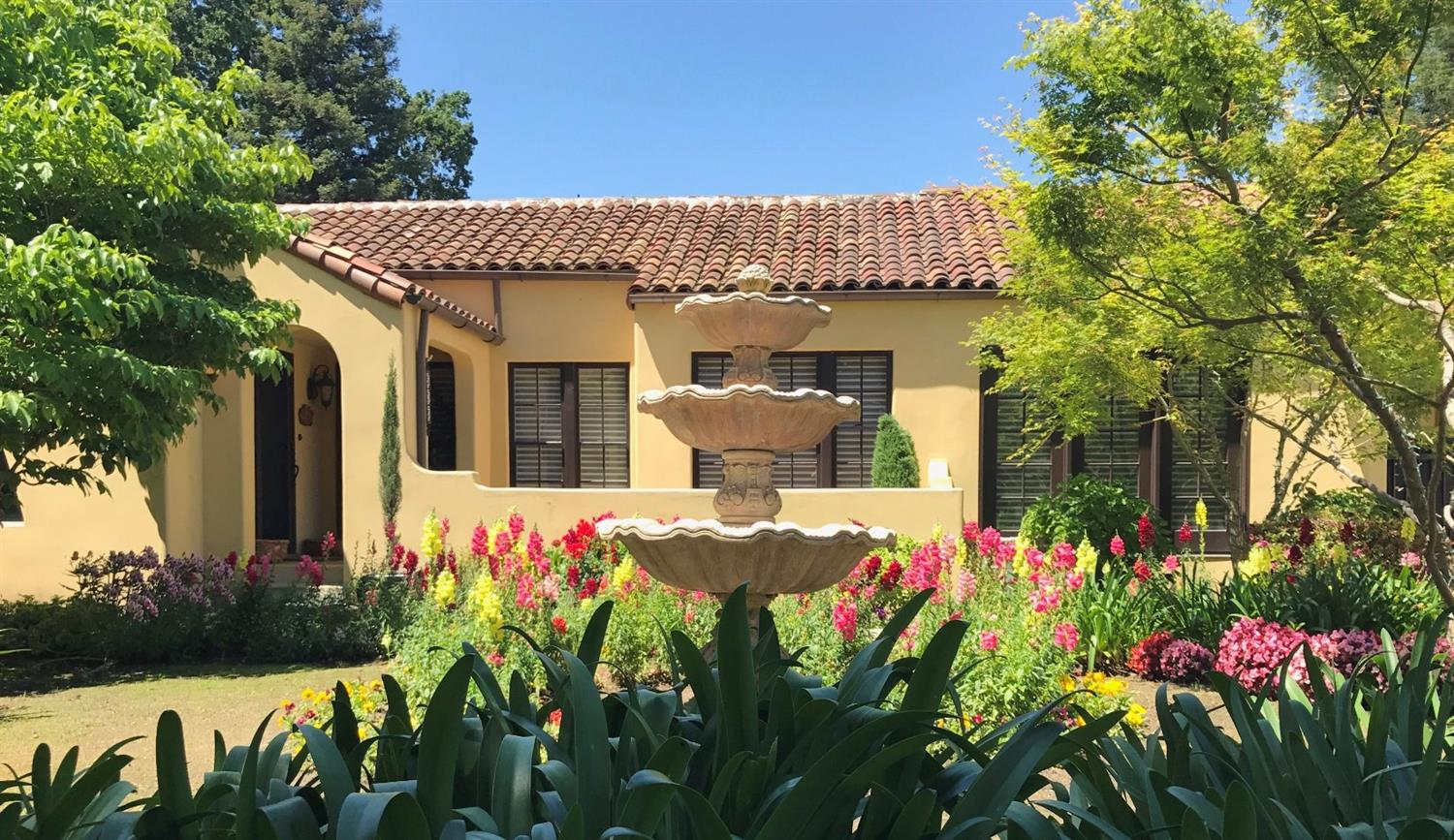 This is a spectacular rare Spanish style custom 2-story home in Old Green Acres. 4BD, 3 1/2BA, salt water pool & spa, w/cabana area.  LR with barrel ceiling, hardwood flrs, lrg. arched window & frplc. Great rm w/Venetian frplc. & double French drs open to patio areas. Library/Study has walls of built-in cabinets.  The gourmet kitchen includes marble countertops, Farmhouse sink,cherry wood center island w/limestone double countertops & prep sink.  Built-in Subzero refrigerator, Bosch dishwasher, garbage bins, all matching cabinety. Also, a freestanding beverage bar matches cabinetry w/built-in beer keg & fridge. Pantry. Bright breakfast rm/lounge area has multi-pane windows & built-in glass front cabinets.  Laundry rm w/sink & full wall of cherry cabinets.  Detached 2-car garage w/studio & 1/2 bath, 2-carport areas, covered driveway (porte-cochere) all behind rolling iron gate. RV parking.  Broker related to Seller.