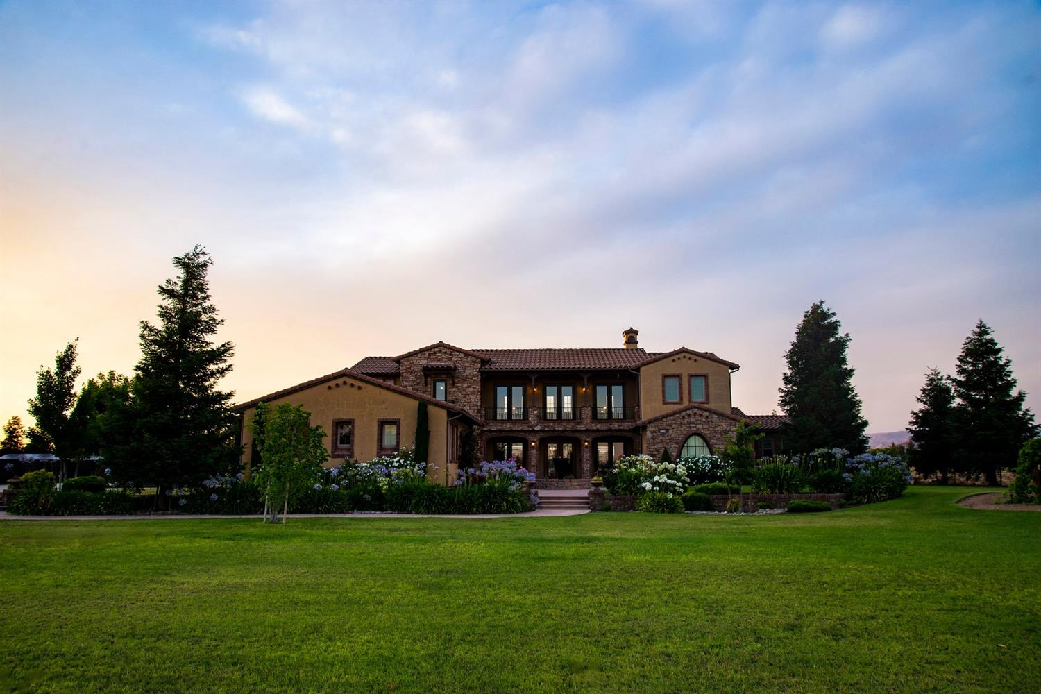 Quality, luxury, taste, and spacious style abound! This home is an entertainers dream! Custom Tuscan style home built with attention to detail by owner /contractor on 2 acres. Every gorgeous detail from the main house to the 783 sf office/ guest casita to the 1200 sf(48x25), outbuilding/ shop with pull through door system is beautifully done. An 8.1kw owned solar system helps everything run to its maximum savings potential. Amenities include, small table grape vineyard, one hole golf course, fully landscaped property, childrens play area. 3000 gallon water storage tank and submerged well pump and propane tank. A virtual feast for all of your senses this property is awesome. Bright spacious rooms, ample storage. Luxury details at every turn. You will  not want to leave this beautiful home.