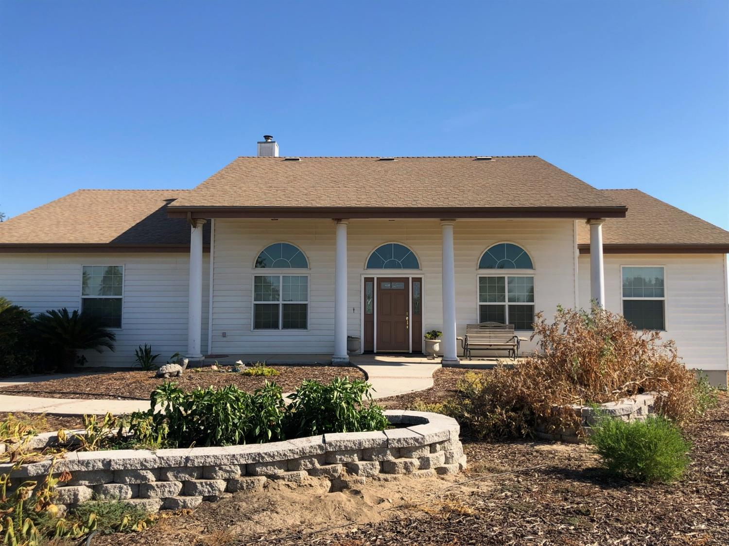 Enjoy a carefree lifestyle on this 40 acre ranch that includes a stunning home.  This is country living at it's best.  The 3,764 square foot home has 3 bedrooms, an office, a formal dining room, a bunk room and much, much more.  The game/family room is approximately 30' by 27' with huge walk-in storage closet.  The view from the living room and kitchen of the infinity pool and vineyard is breathtaking. Vineyard is Thompson Seedless and is currently leased to a local farmer.  The 2018/19 crop belong to the seller and farmer.