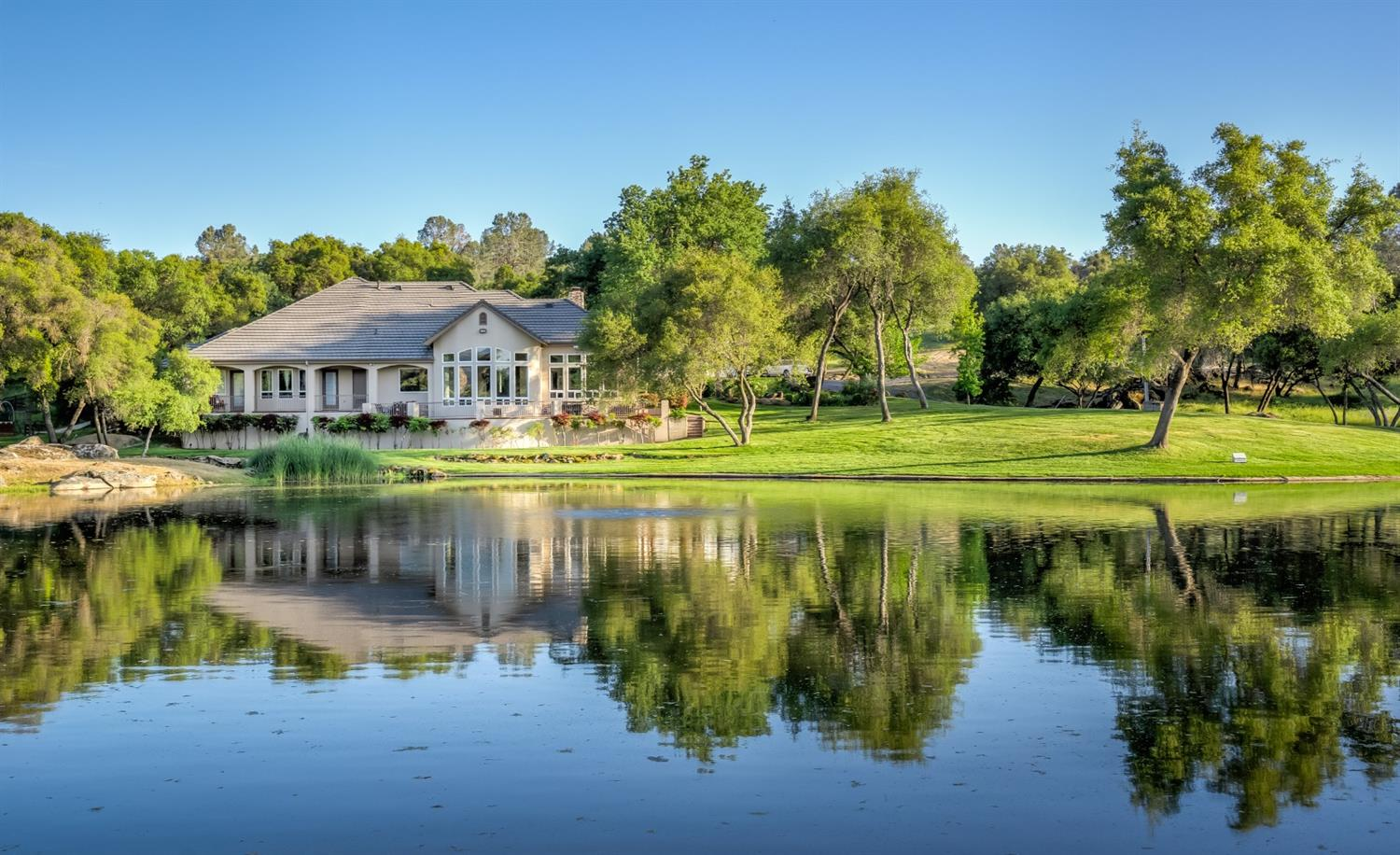 This stunning residential provincial estate is nestled in a harmonious rural setting spanning approximately 120 acres on two contiguous parcels. Embraced by a region known for premium terroir, renowned vineyards, and Meditteranean climate, this property endows a unique agriculture opportunity and development potential. Diamond Springs Ranch is suitable for various agriculture pursuits: Agri-tourism operations, Gentleman's Ranch, equestrian operations, commercial grape and/or olive production, vacation rental and wedding venue opportunities. There are two wells with abundant water for existing ranch uses or potential for a new vineyard in the highly acclaimed Madera Wine Trail. This spectacular estate grants a sophisticated turn-key opportunity with an upscale home that features a neutral palate, Terrazzo flooring, cathedral ceilings, and attractive design elements. The kitchen, including a walk-in pantry and wine cellar, offers an open floor plan for casual yet elegant entertaining.