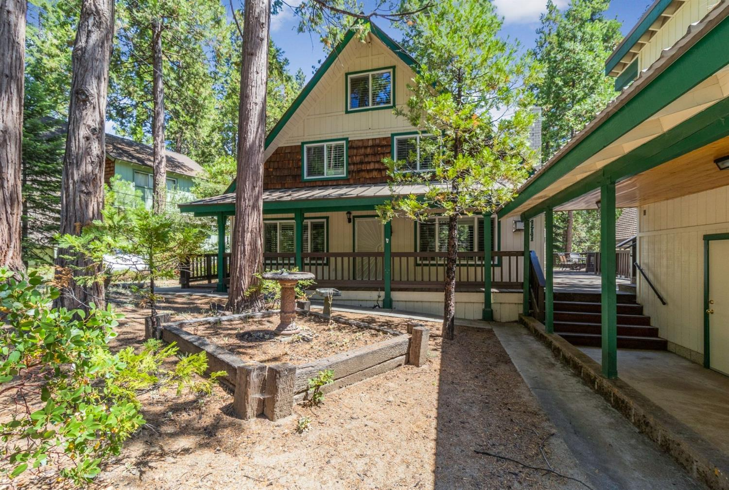 Charming cabin in the East Village! Great location, close to Shaver Village as well as the lake. Open concept kitchen, living, and dining. Kitchen has granite counter tops and stainless appliances. Master bedroom and bathroom on the main level. Upstairs there are 2 more bedrooms with a bathroom and game room.  The 3rd floor attic was converted to large bedroom which can sleep 8 or more.  Large outdoor porch areas, great for entertaining. There is a cozy guest house with updated bathroom and loft bedroom. Large workshop and/or storage area over 3-car garage. Ample parking with large paved area for your guests. Home has dual-pane windows and plantation shutters throughout. Come see all it has to offer!