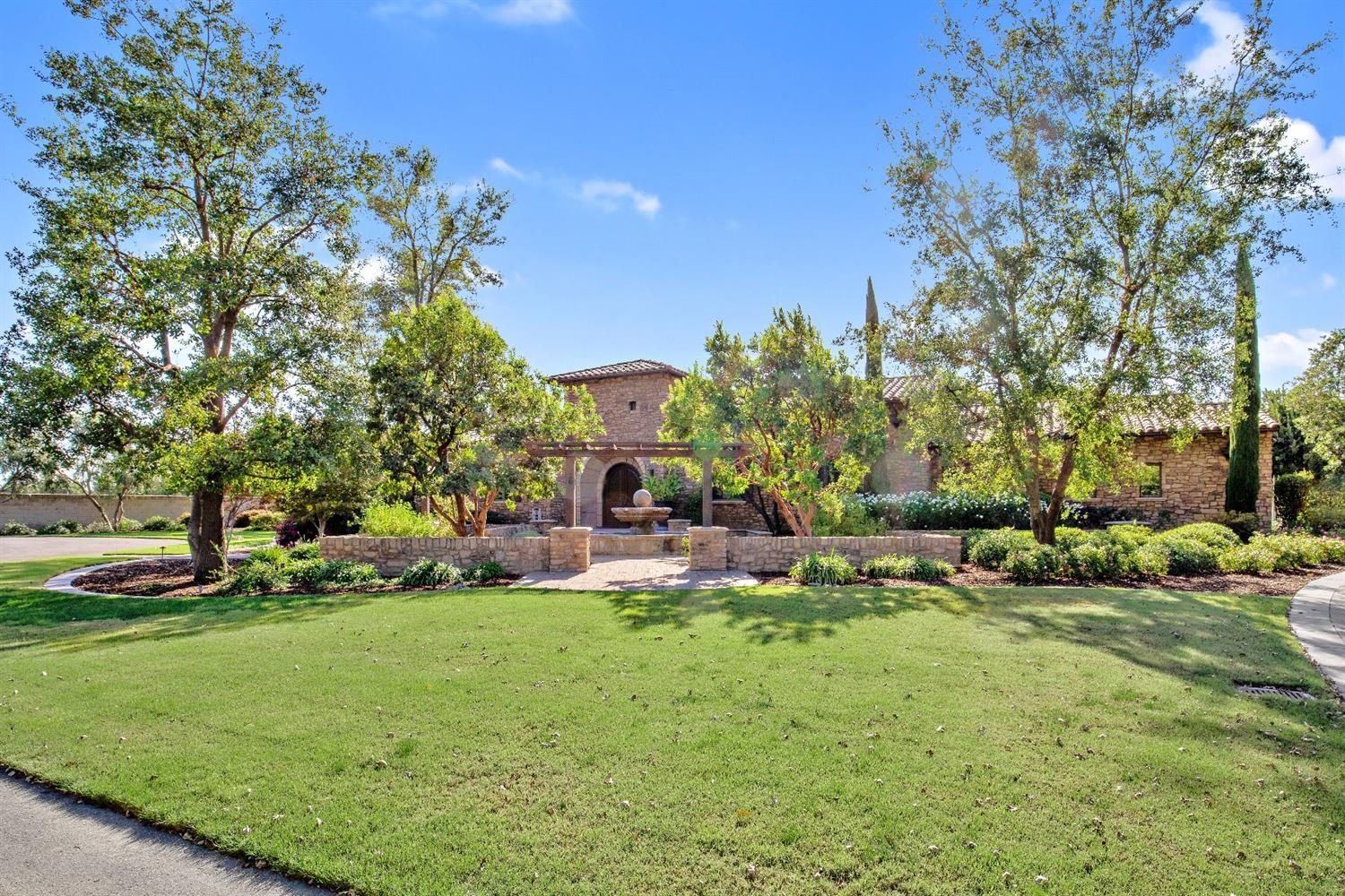 Residing on a spacious 1.3 acre lot in Visalia, this beautiful Tuscan style home is an entertainers dream. Host family and friends inside the 6,719sq. ft. home complete with a Butler's kitchen, separate full kitchen complete with upgraded appliances, and a dining room table that seats 14+ people. Escape to your master bedroom while children are playing in the over-sized game room. The master features his and hers closets, toilets, and vanities. Relax in your sunken in jet tub or opt for a steam shower. Separate Casita with bedroom, full bath, and kitchenette. There is also a large game room with restrooms by the pool. Additional features: exterior cameras, large sliders to the pool, fruit trees, two separate offices, and parking accommodations for 20 vehicles. If you are interested in viewing this listing, please contact us today!