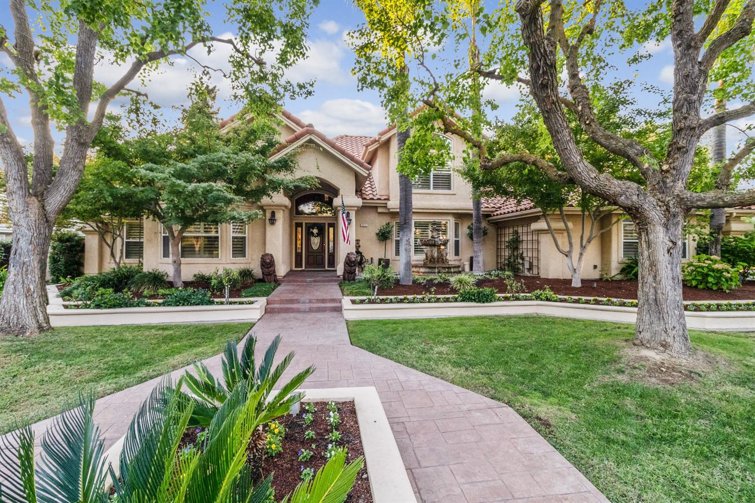 Stunning custom home in Ft. Washington's Country Club Estates.This beautiful home sits on a lg corner lot of mature landscaping & features a 3 car garage. Walking up the entry you are greeted w/a beautiful 3 tiered stone fountain. Many custom touches are throughout every room of the home. Beautiful built-ins, moldings, stone work, iron railing, ceiling fans, surround sound & refinished cabinetry. Downstairs features a private library, 2 of the 3 brs, including the master suite with sitting area, his/hers closets w/ organizers. The entry leads you to a formal dinning, lg living room w/vaulted ceilings, gas fireplace & wet/bar w/wine fridge & built-in cabinets. Spacious kitchen features stainless steel app, custom cabinets, pantry, island w/prep sink, breakfast bar, new wood floors & eating area overlooking private backyard. Backyard features covered patio w/fans & lighting & pool w/stone waterfall perfect for entertaining. Upstairs has a lg bonus room w/built-ins, & bedroom w/bath.