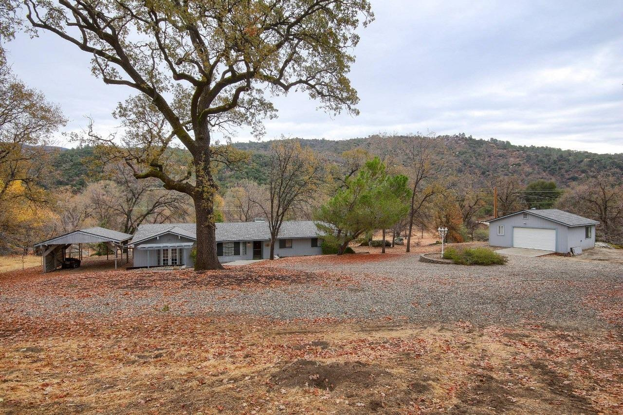 Fantastic opportunity is knocking! Lovely 3 BD, 2 BA home w/living, family & bonus rooms w/brand new (2019) roof & heat/air. From the time you see this charming home, you'll imagine the possibilities! The front offers peaceful views of lg. trees & gentle land from the porch. The living room greets you w/an open floor plan, family room & even a bonus room. The kitchen offers a lot of tile counter space & cabinets. Enjoy the bonus room w/built-in entertainment center & french doors. The BDs are roomy w/a master suite that includes sliding glass door to the outside above ground spa & separate vanity & toilet/shower areas. The back yard has a great spot for barbecues w/the covered patio, side patio areas & beautiful views. Sweeping driveway cir