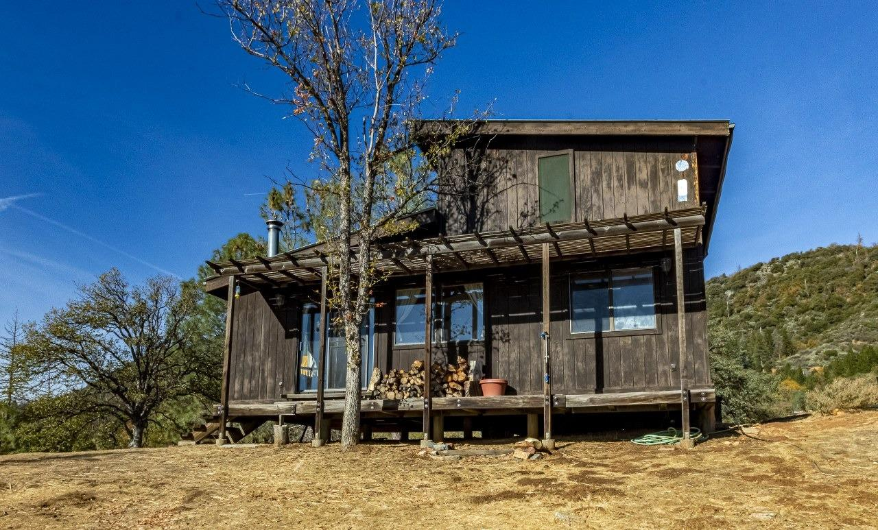 If you're looking to get away from the city and want acreage and a cabin to enjoy nature, well, here is the place. 20+/- acres to roam around on, hunt, run your ATVs, snowmobiles or ride your horses on. Most of this property is fenced and even with some cross-fenced areas. Be sure to take note of the gated access to the national forest directly from your property as this acreage does back up to the national forest. The 2 bedroom, 1 bath cabin is sitting near 3800 foot elevation, so you will have all seasons at this property. The cabin is really self sufficient with having solar panels, battery backup and a tankless water heater. Propane tank and water storage tank on the property. There is an in ground hot tub that is wood fire heated as we