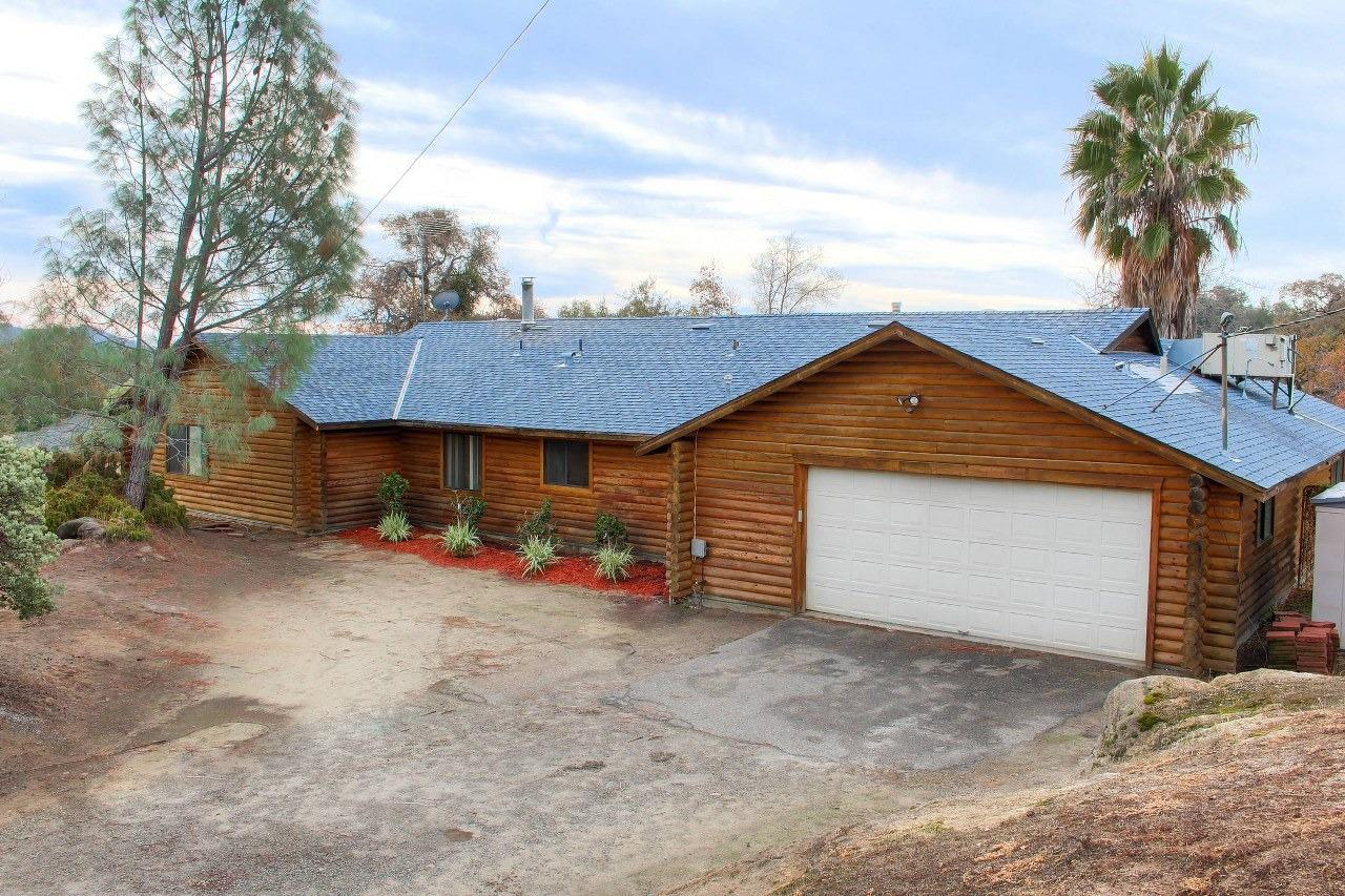 Wonderful Log built mountain home with views and built-in pool. If you are looking for something different, then this could be the one for you. Large home is 2578+/- sq. ft. with knotty pine ceilings and walls throughout this 3 bedrooms, plus office, 2 bathrooms and 2 car garage, sitting on 1.35+/- beautiful acres. Nice big living room, with spacious kitchen for the chief in the family to include 6 burner gas stove, lots of storage and counter space, dining area and breakfast bar. Enjoy hanging out by the built-in swimming pool surround by wonderful views. Rock outcropping and plenty of patio and decking to entertain family and friends.