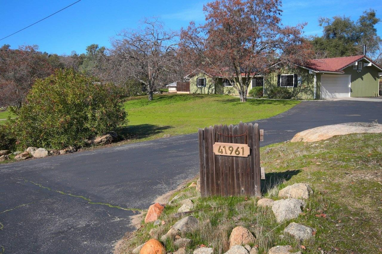 This is your chance to live in a single story 3 bedroom, 2 bathroom 1718+/- sq. ft. home with a 2 car finished garage on 1.05+/- acres in the foothills of Coarsegold!  Property is in a quiet cul-de-sac.  There is a separate living room and family room with tile floors.  The bedrooms are carpeted and spacious with ceiling fans throughout.  The kitchen provides a 5 burner range, dishwasher and disposal.  Leased solar is provided with no added fees.  Enter the fenced back yard with a waterfall among wonderful landscaping along with an inviting hot tub.  Look beyond to see the good sized shed as well.  The land is all usable with a great front and side yard.  This is priced right and should go fast!