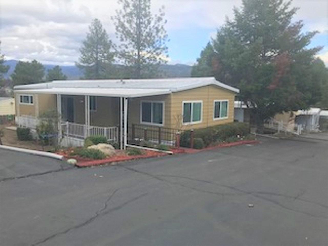 This is a very well maintained home in the centrally located Oakhurst Mobile Home park. Recently the exterior has been beautifully painted, open floor plan, new tinted double pane windows installed and master bath is beautifully remodeled. The sliding glass door leads to a nice covered deck. Front yard is landscaped with drip system. Come and see this lovely home.