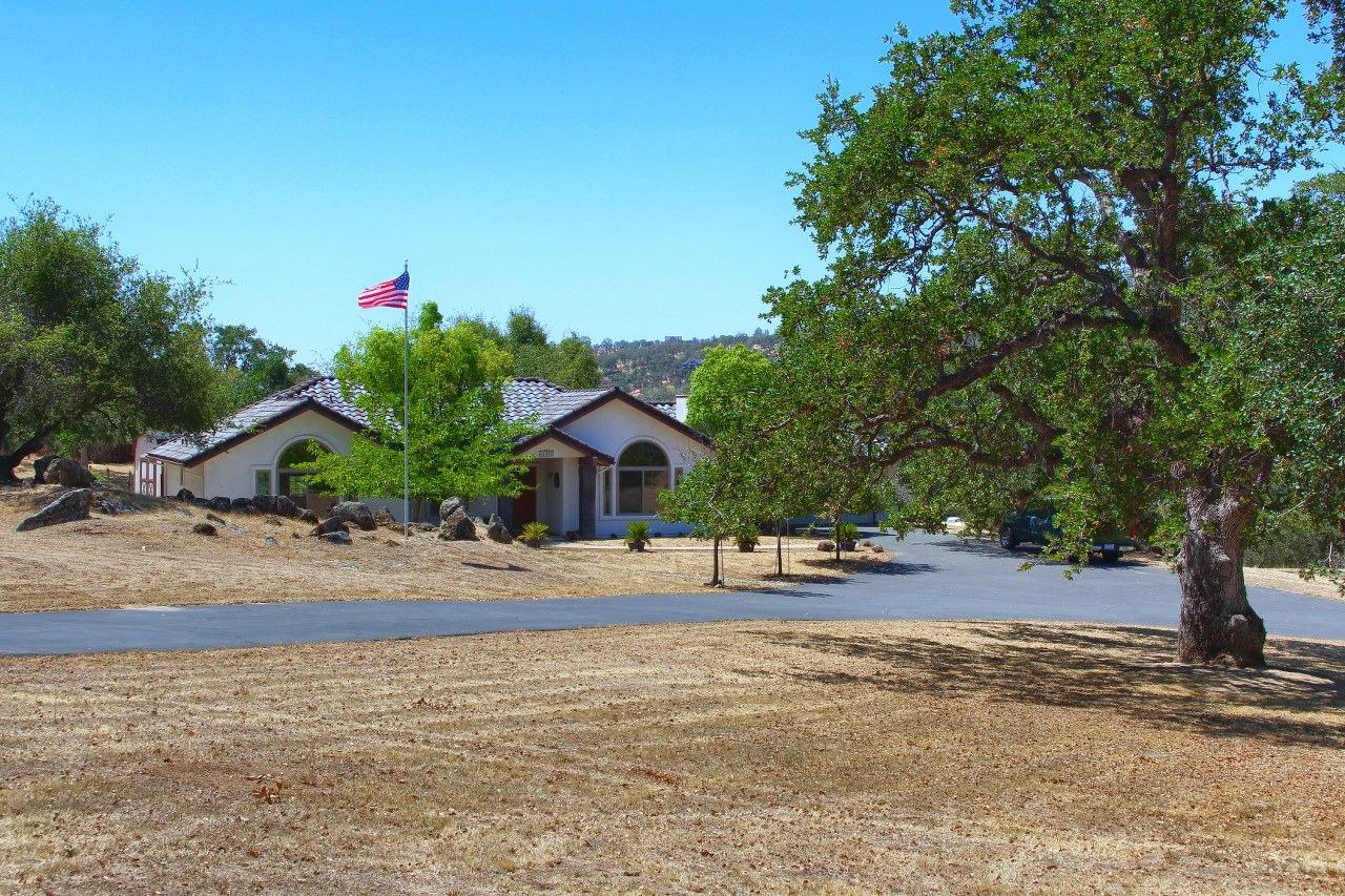 This is your chance to live in a single story 3 bedroom, 21/2 bathroom 1959+/- sq. ft. Bricker Built home with a 2 car garage on 1.29+/- gorgeous, flat acres in the foothills of Coarsegold! Property is in a quiet cul-de-sac. Kitchen was redone in 2008 with all new appliances, such as dishwasher, disposal, oven and stove top, reverse osmosis, water softener, tile floor and granite counters which include breakfast bar/island. Beautiful self-closing custom cabinets and separate dining area with built-in cabinetry, and all open to the spacious living room with gas fireplace and vaulted ceilings. The bedrooms are carpeted and spacious with the master bedroom having a nice walk-in closet. Stroll out to the back patio and sit under the gazebo for