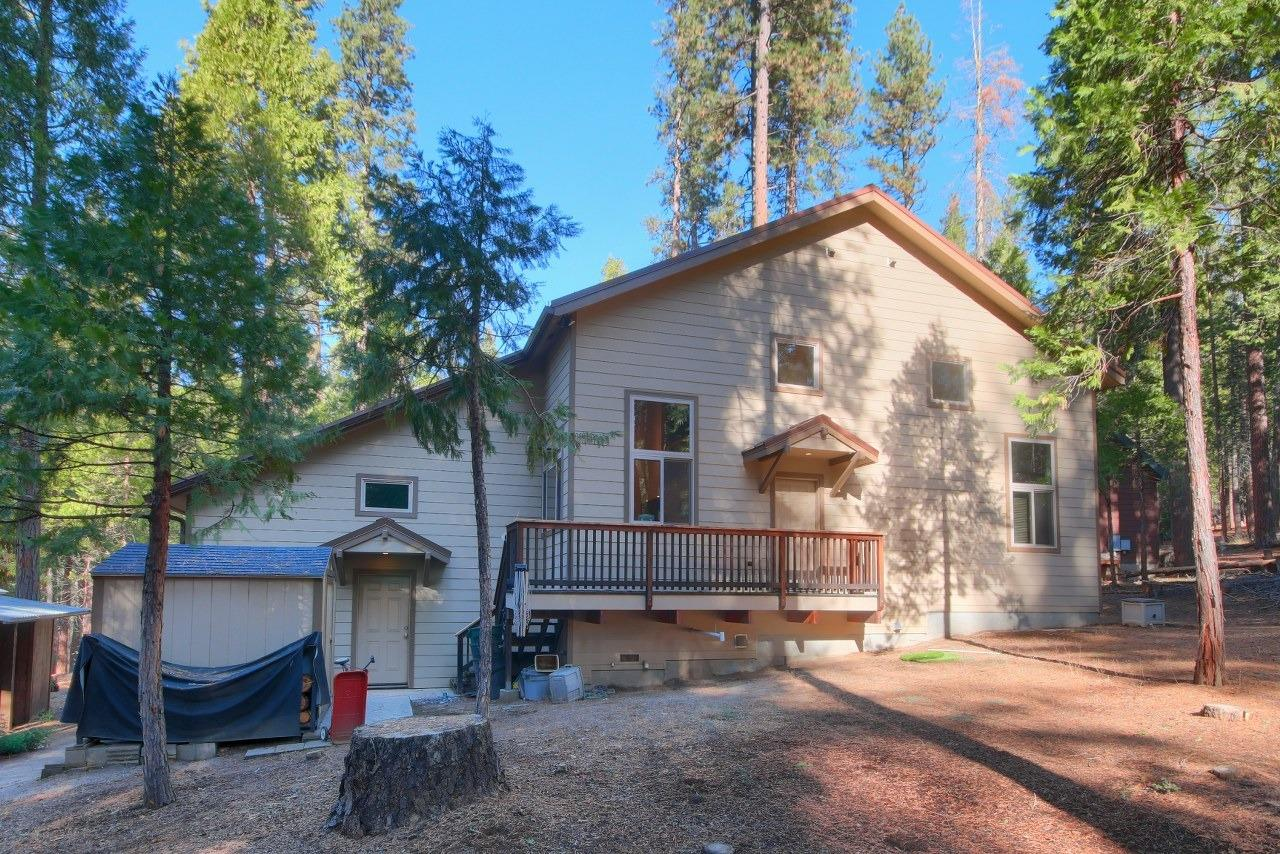 Wawona Mountain Retreat in Yosemite National Park!  This 2013 custom built home has 3 nice sized bedrooms, 2 bathrooms with 1420+/- sq. ft. and additional 400+/- sq. ft. loft for added comfort. Large front deck to entertain from. And plenty of room to park on this large .24+/- acre lot.  Includes a 2 car insulated garage with a high ceiling for added storage if desired. The living room offers a freestanding wood burning stove and opens to the dining area and the kitchen is spacious for those who love to cook. Lots of granite counters, along with large kitchen island, beautiful knotty pine cabinets, gas range, microwave, dishwasher, trash compactor and water softener system. Pull down the stairs in the hall to enter the adorable loft, would