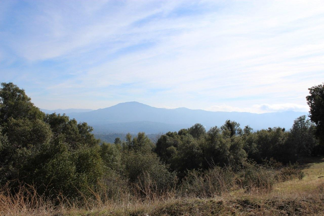 Desirable Ahwahnee 5.04+/- acres with lovely views! The property has a county approved pad and septic installed. Great location near the Ahwahnee post office and Highway 49 for commuting. This is a wonderful place for your new home!