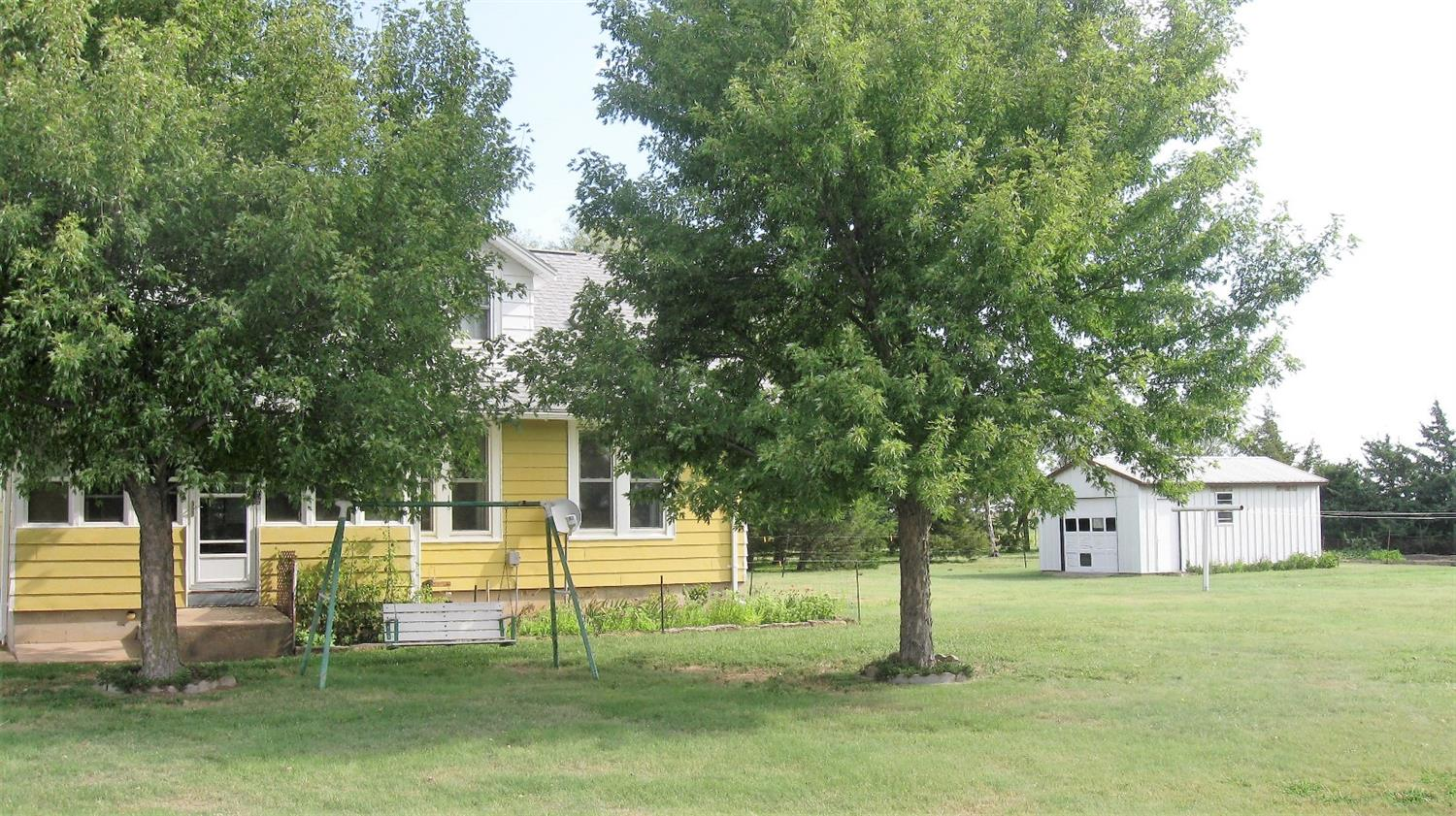 Looking for a Beautiful Country Property? Look no further this is the one! Great older 1 1/2 story country setting on almost 5 acres. House was moved in, in 1995. 4 car garage, 30 x 50 shop, barn, and garden shed. Extra clean & well maintained property 11 miles from GB all blacktop.