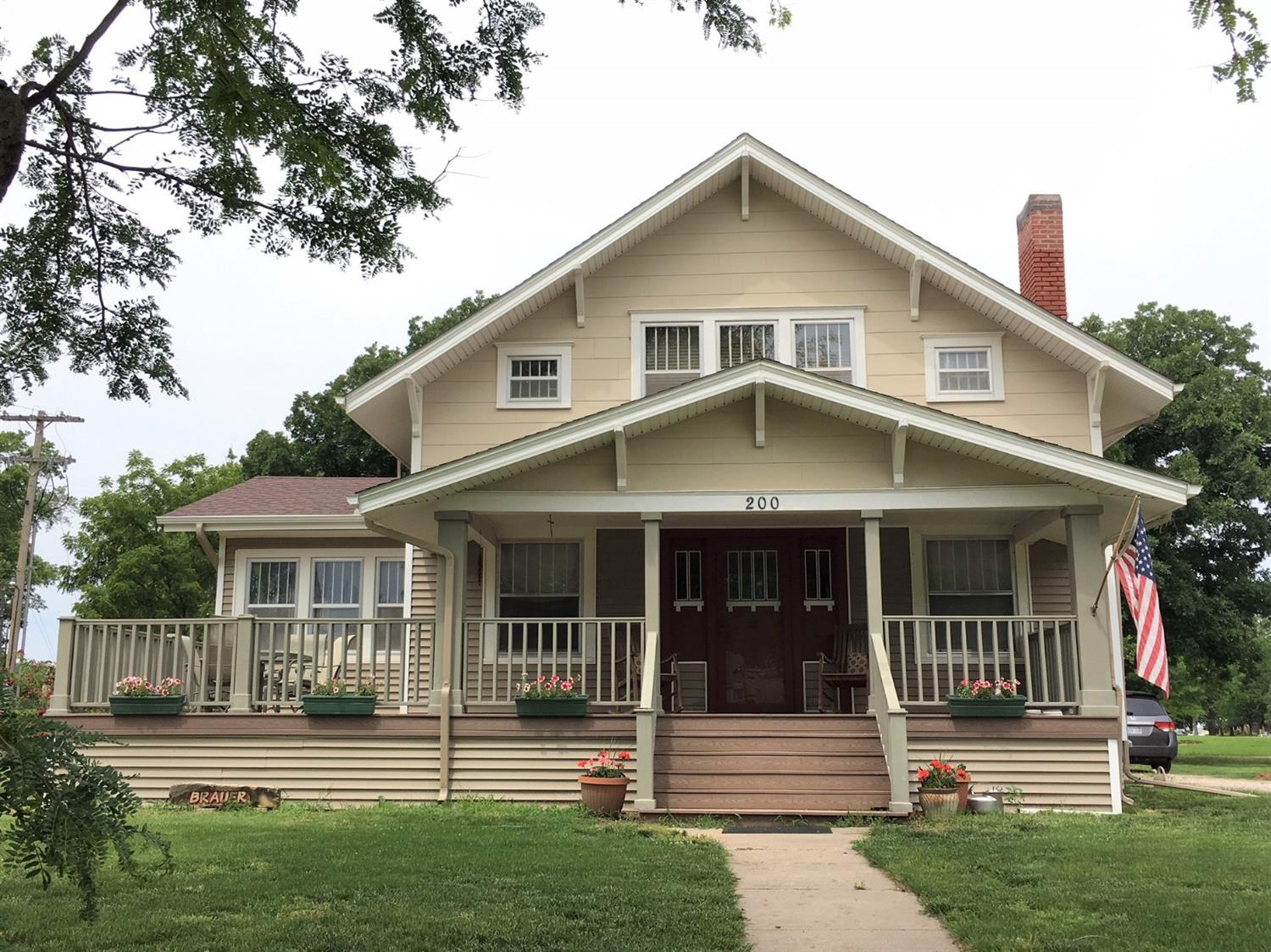 REDUCED over $15,000 from original list price!! CLASSIC character & charm PLUS, Great location. Large corner lot. Golf course is just a swing away! 4 bd/1.75 bath with BEAUTIFUL, original woodwork, built-in cabinets, hardwood floors, large rooms & closets with TONS of space. Utility & bath on main floor w/walk in shower. Plus, a cozy sunroom with an abundance of natural light. Full, unfinished basement. Partial privacy fence. Call today to view this GORGEOUS home!
