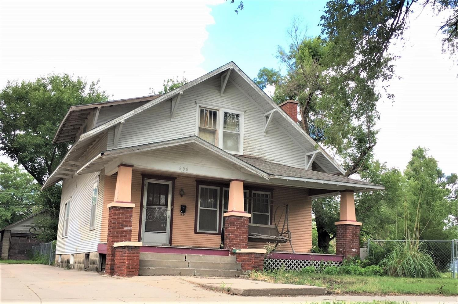 GRACIOUS!....How spacious! With some TLC this 4 bed(main floor/non-conf.) 1.75 bath home could be your pride and joy. Original woodwork. Gas fireplace. Large living room and dining room. Partial, unfinished basement. HUGE double/corner lot with fenced in yard. What a bargain!