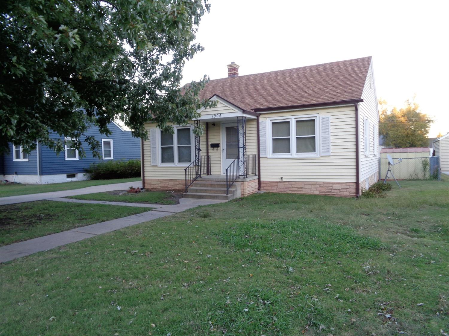 This home features replacement windows throughout home including basement. 2 bed/1 bath home with hardwood floors under carpet. Maintenance free exterior.