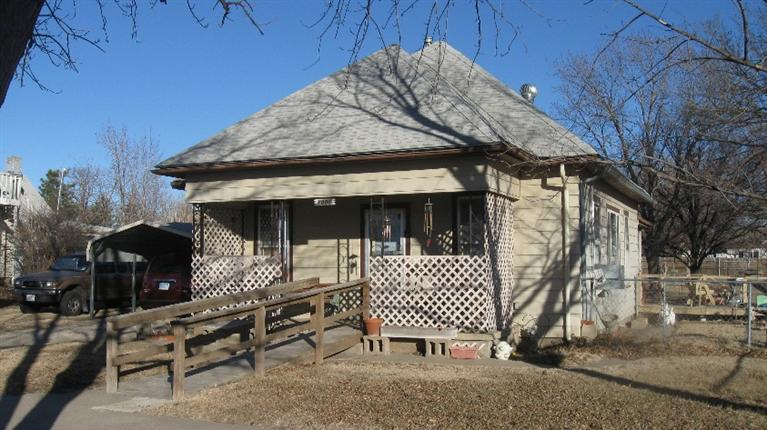 Good Starter or Rental Home. This steel sided 2 bedroom, 1 bath has single detached garage and carport plus extra lot to 10th street.