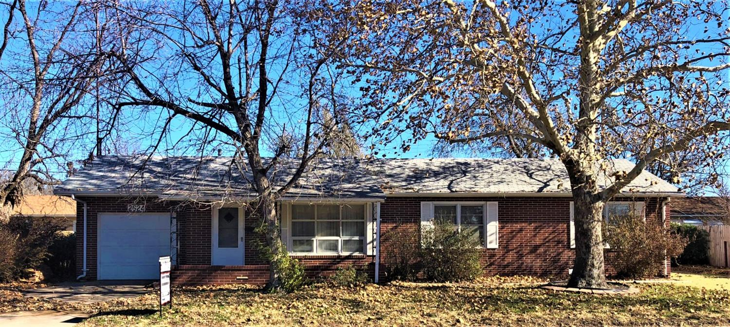 Well built brick ranch style home with covered front porch, open living room and dining room, kitchen, 3 bedrooms, 1 bath, utility room, FA & CH, storage building plus S/A garage.
