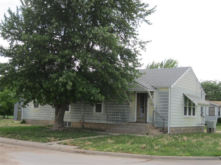 *NEW PRICE!*  PERFECT starter or investment home... Want quiet, small-town living? Then this is the home for you! Nice corner lot. Across from ball field & park with plenty of room to play. Close to downtown-shopping, antique stores, restaurants, convenience stores & Dollar Store. NEW ROOF, Newer water heater, newer windows,original wood floors under carpet! An ABUNDANCE of storage space w/single attached garage & partial unfinished basement. Small metal storage shed behind house IS included. Large metal garage IS NOT included w/ property. Previously rented for $450.00/month.