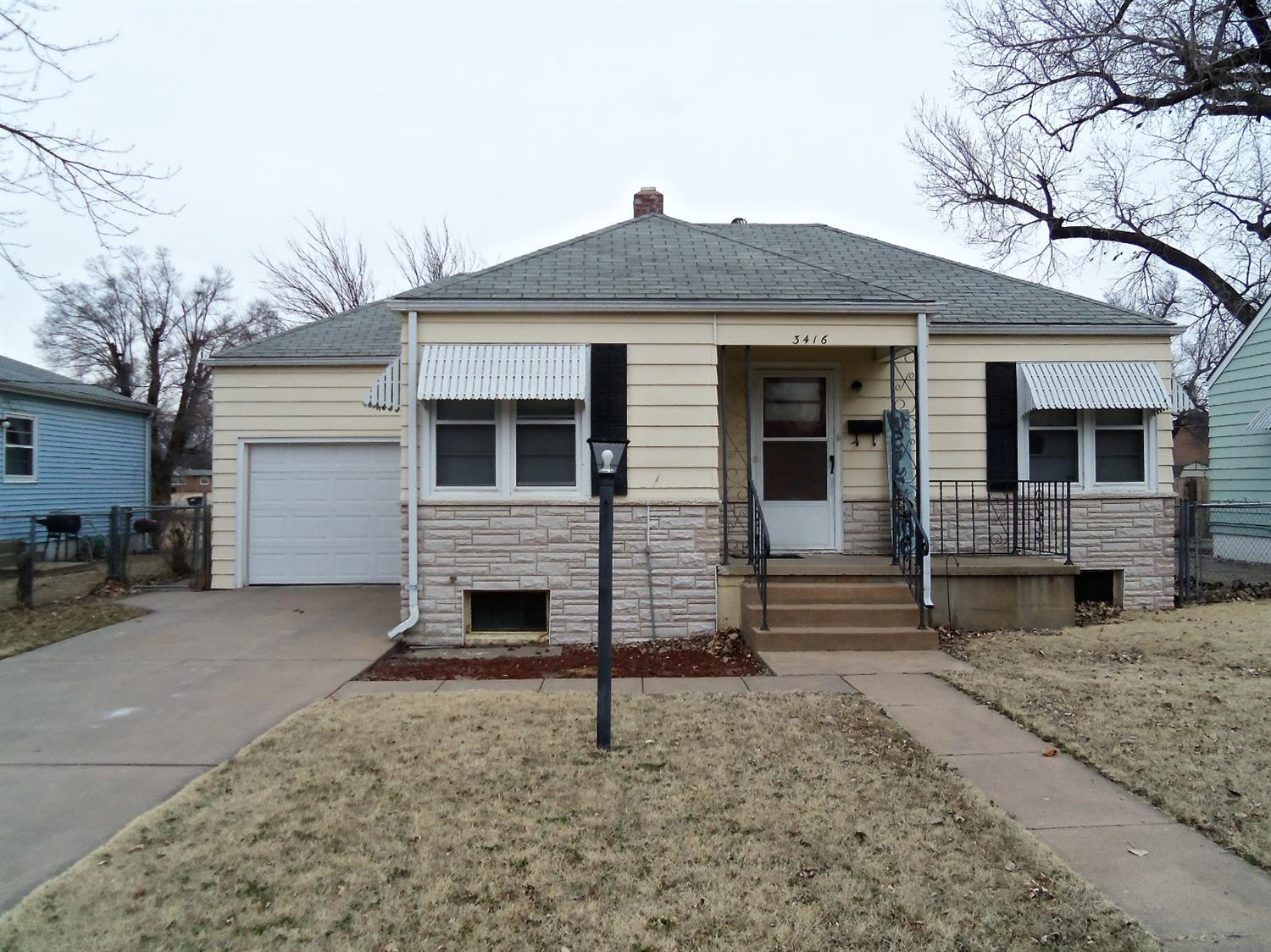 Steel sided 2 bedroom home, beautiful hardwood floors, eat in kitchen, full bath, CH & CA, added insulation in the attic, electrical and plumbing updates.  Full unfinished basement, single attached garage, covered patio and chain link fenced back yard, with alley access.