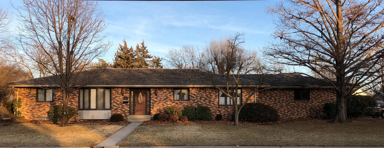 Well built brick ranch style home featuring formal living room, family room with w/b fireplace, spacious kitchen with dining area, 3 bedrooms, 2 1/2 baths, finished basement with rec. room, bar, and 4th bedroom, FA & CA, covered patio, sprinkler system plus double attached garage.