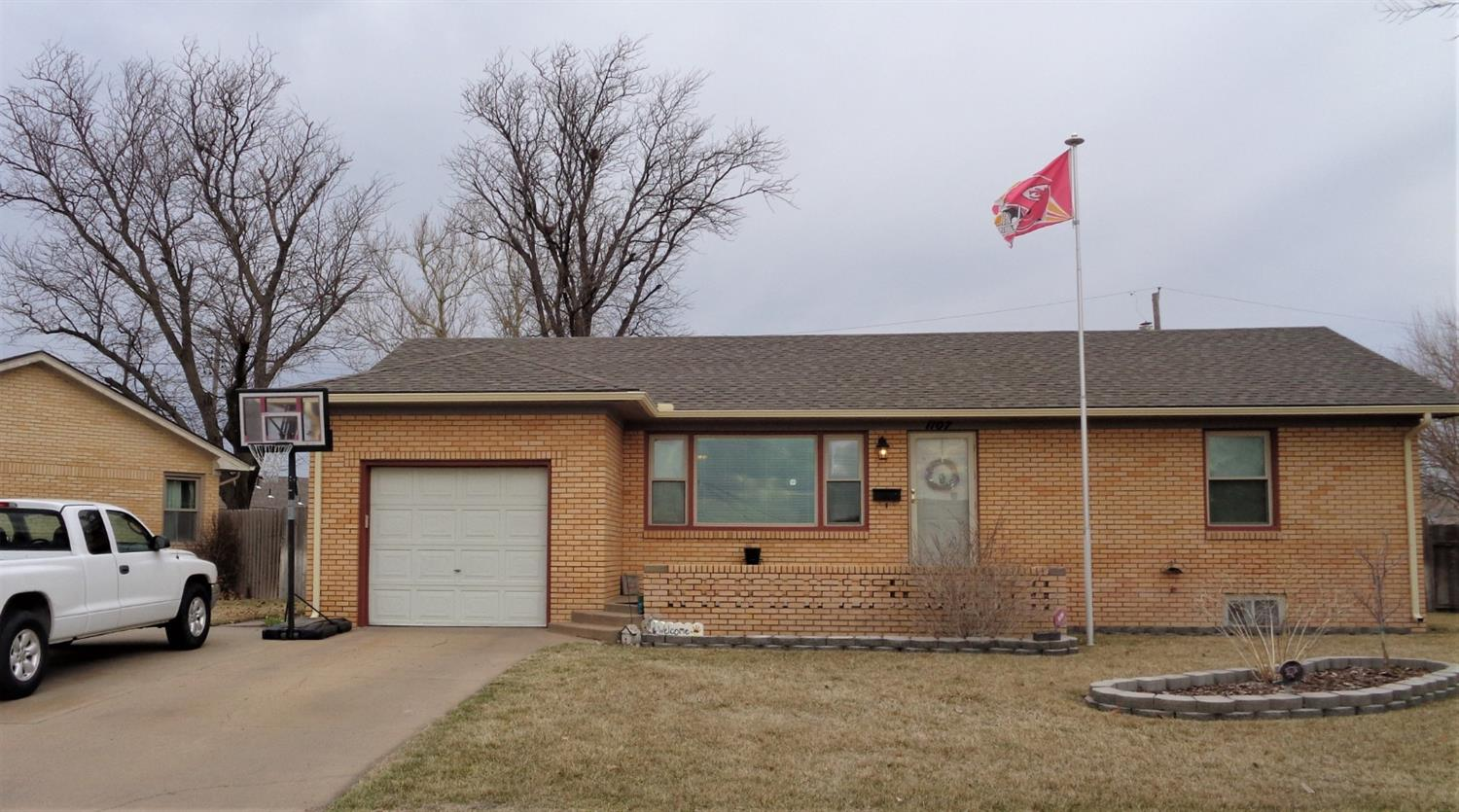 Nice brick home, move in ready. Spacious living room, kitchen with breakfast nook and refrigerator and stove, plenty of cabinet space, two large bedrooms, full bath and main floor utility room.  CH & CA, some replacement windows.The basement has family room with wet bar, two non-conf. bedrooms, 3/4 bath and office and mechanical room. Single attached garage with double drive for extra parking, privacy fenced yard with sprinklers, garden space and garden shed. Sell contingent on homeowner purchasing another home.