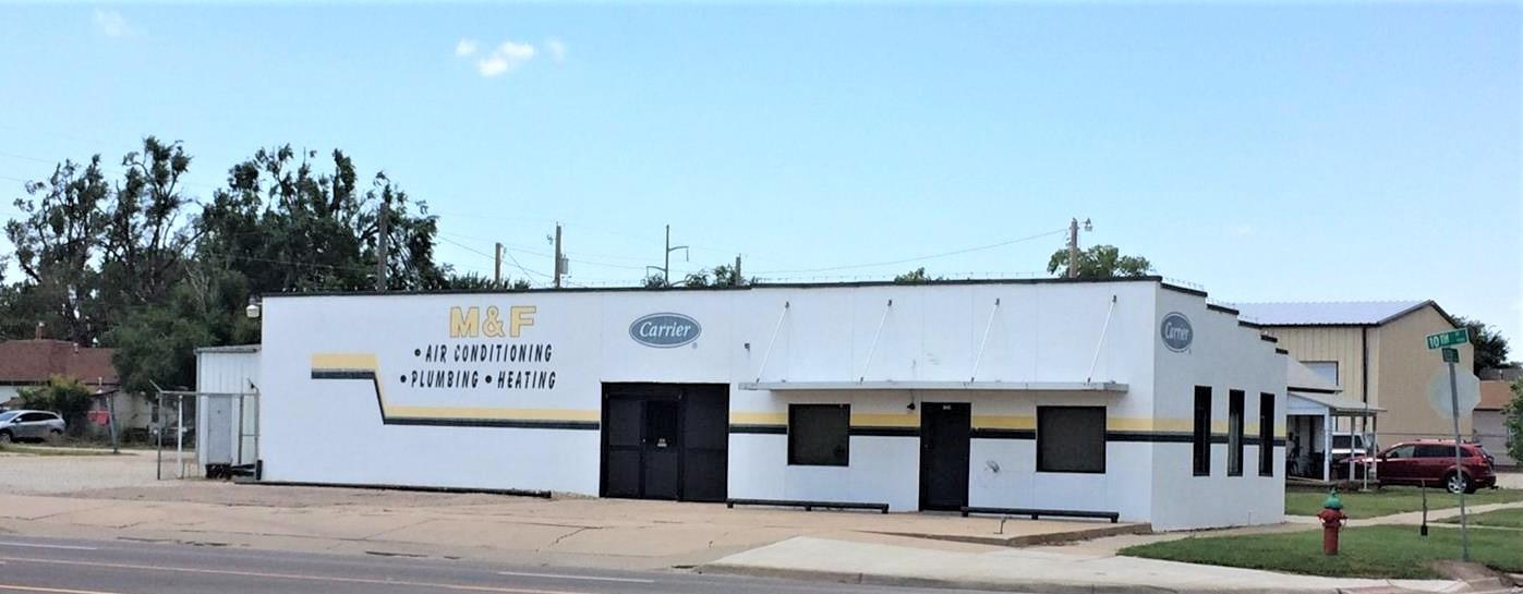 Retail or office building with 702 sq ft and CH/CA.  1150 sq ft warehouse with heat. Great 10th Street location with off street parking.  Selling AS IS.