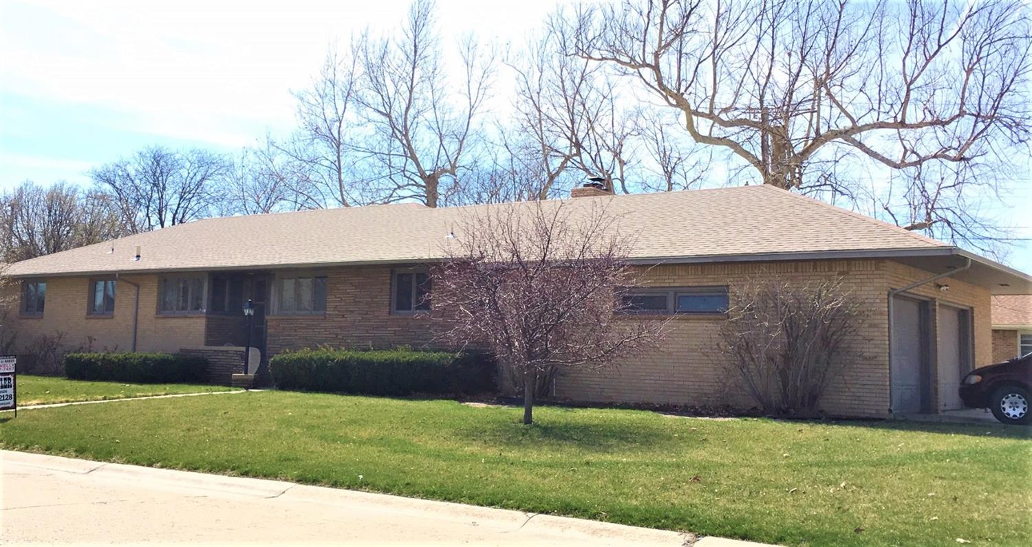PRICE REDUCED!! Desirable Crescent Park Addition! Need SPACE?! You NEED this beautiful 4 bed/2.5 bath home. Over 2,000 sq. ft. on just the main level! Remodeled kitchen. Utility/laundry on main level. Wood burning fireplace. Full finished basement w/ family room, wet bar, craft room & TONS of storage. Back deck is wheel chair accessible. 2 car attached garage. Aristocrat Pear & Prairie Fire Crabapple trees in front yard. PLUS extra parking space for RV or camper!