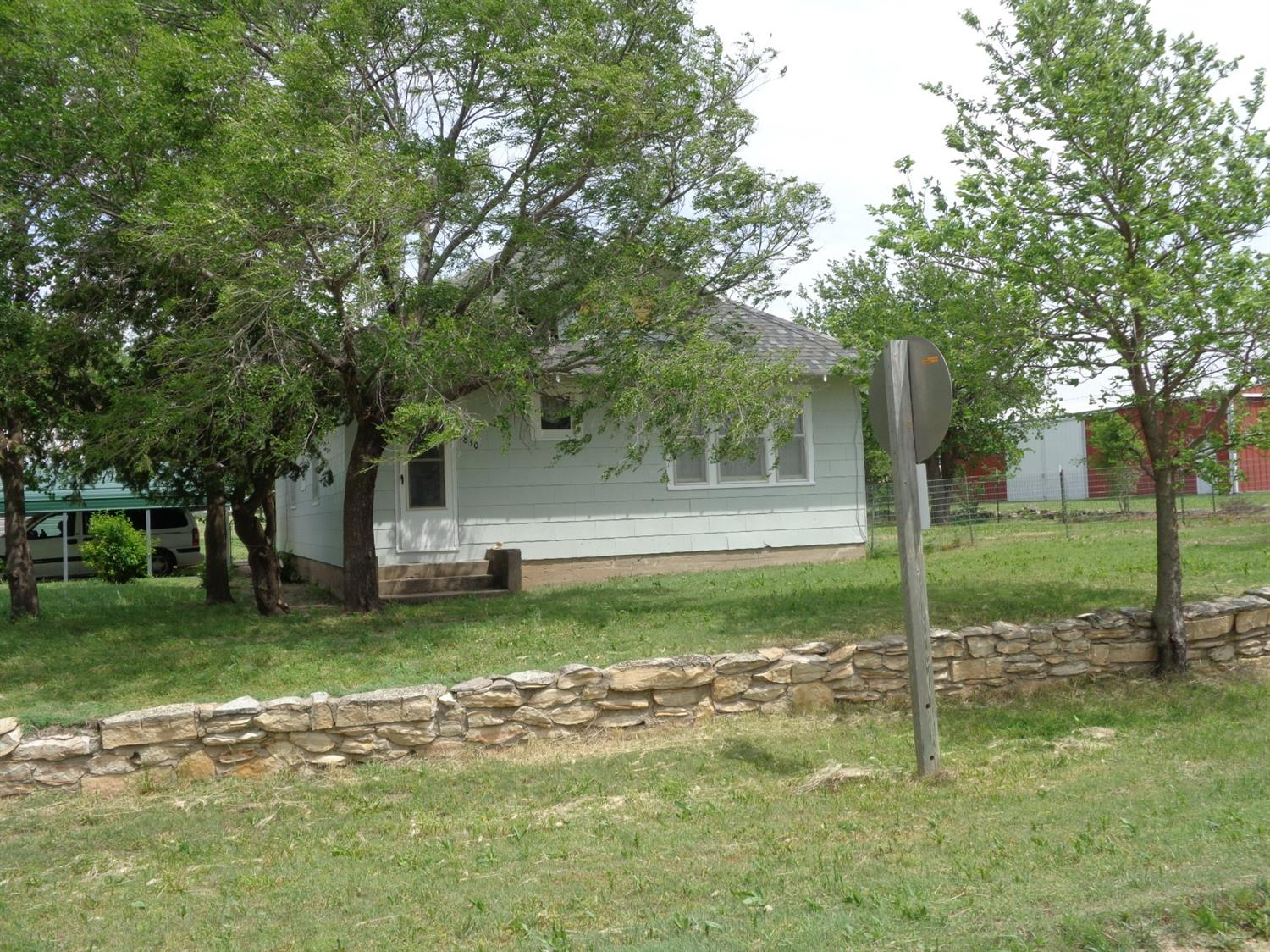 Country home sitting on 1.5 acres, with out buildings.  2 bed, 1 bath, electric baseboard heat, new paint, newer roof & new flooring in kitchen.
