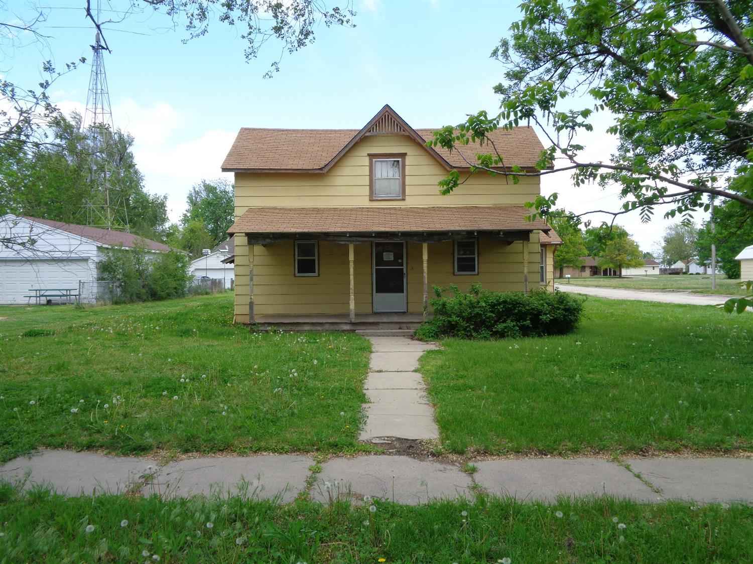 Large home with Large double attached garage (42 x 29'6) on corner lot.  Storm shelter in garage.  This property is Selling AS IS.