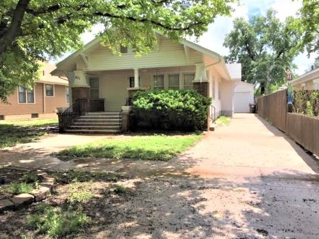 Lots of Charm is this 3 bedroom 1 bath traditional home. It features an updated kitchen by Kustom Floor Designs in 2001. updated bathroom. Large living and dining rooms with beautiful hardwood floors under carpet. An insulated & heated 24x36 detached garage with a metal roof and 10' sidewalls. There are 2 automatic garage doors on each end of garage and you have alley access. Very well maintained home. Call today for your showing!