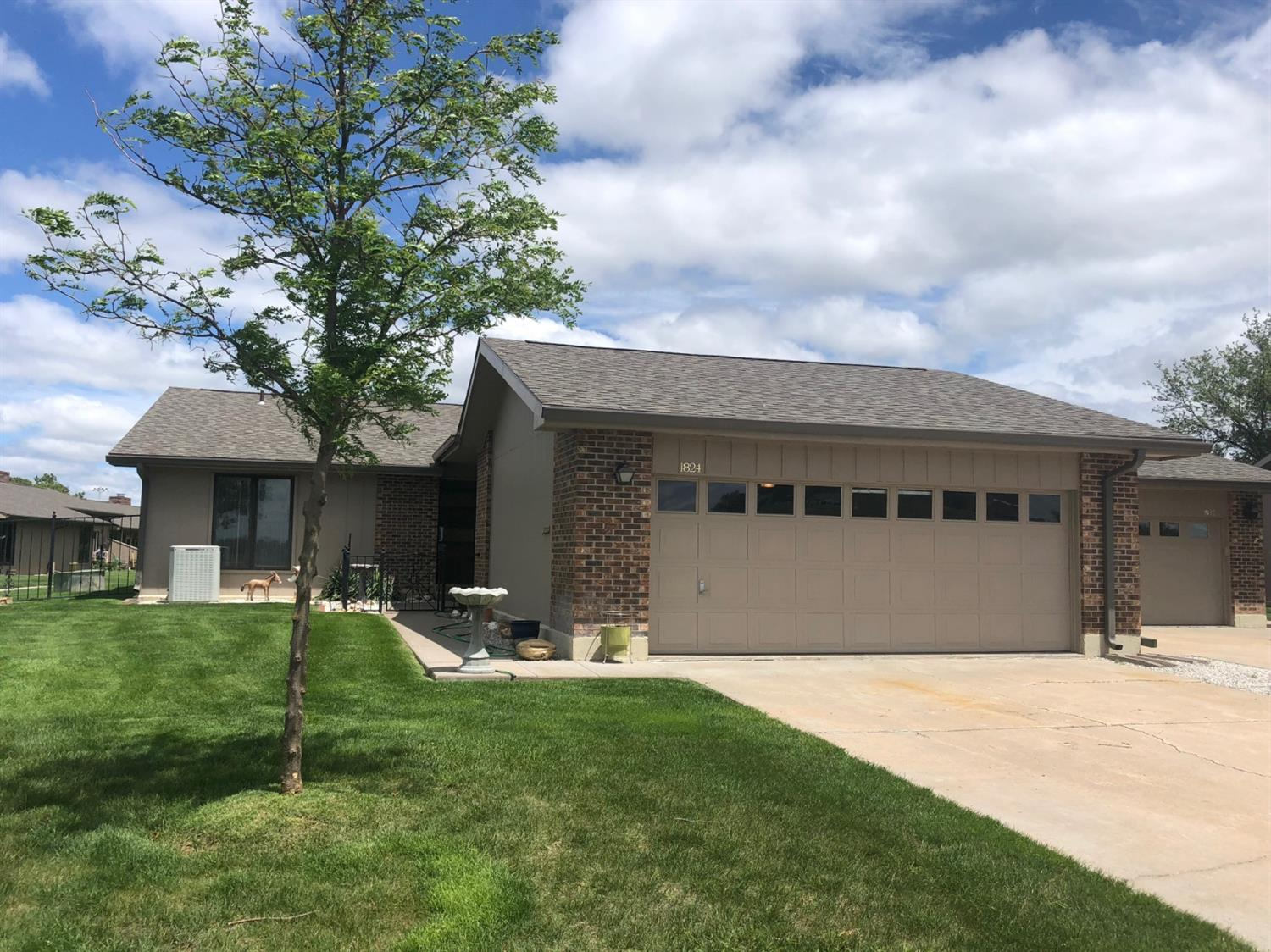 Nice Parkwest Townhouse with formal living room with w/b fireplace, dining room, remodeled kitchen in 2007, 2 bedrooms, 2 bathrooms, Pella windows, CH/CA and D/A garage. HOA covers lawn, snow removal, pool maintenance, trash, termite contract and exterior maintenance.