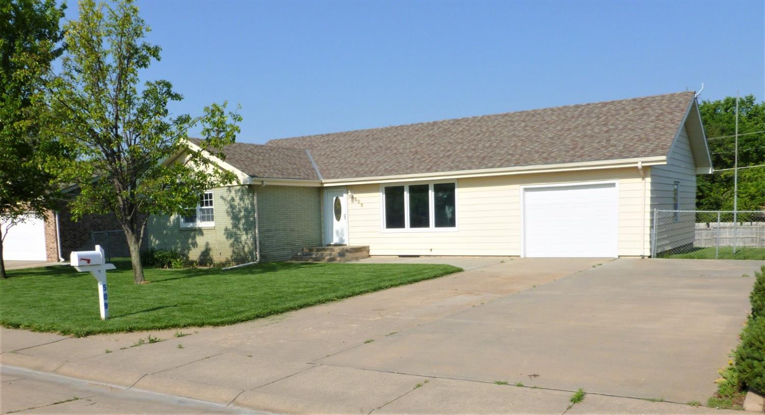 YOU HAVE TO SEE this newly remodeled home in great neighborhood in Hoisington.  Gorgeous only begins to describe this 4 bedroom 2 bath house with totally open floor plan. The 1244 sq ft main floor includes a new, remote controlled, ventless gas fireplace as the centerpiece of the living space. Bathrooms and fixtures are modern and tastefully done. Whoever buys this home can do their laundry on the main floor or in the basement utility room. Don't wait to schedule your showing!!