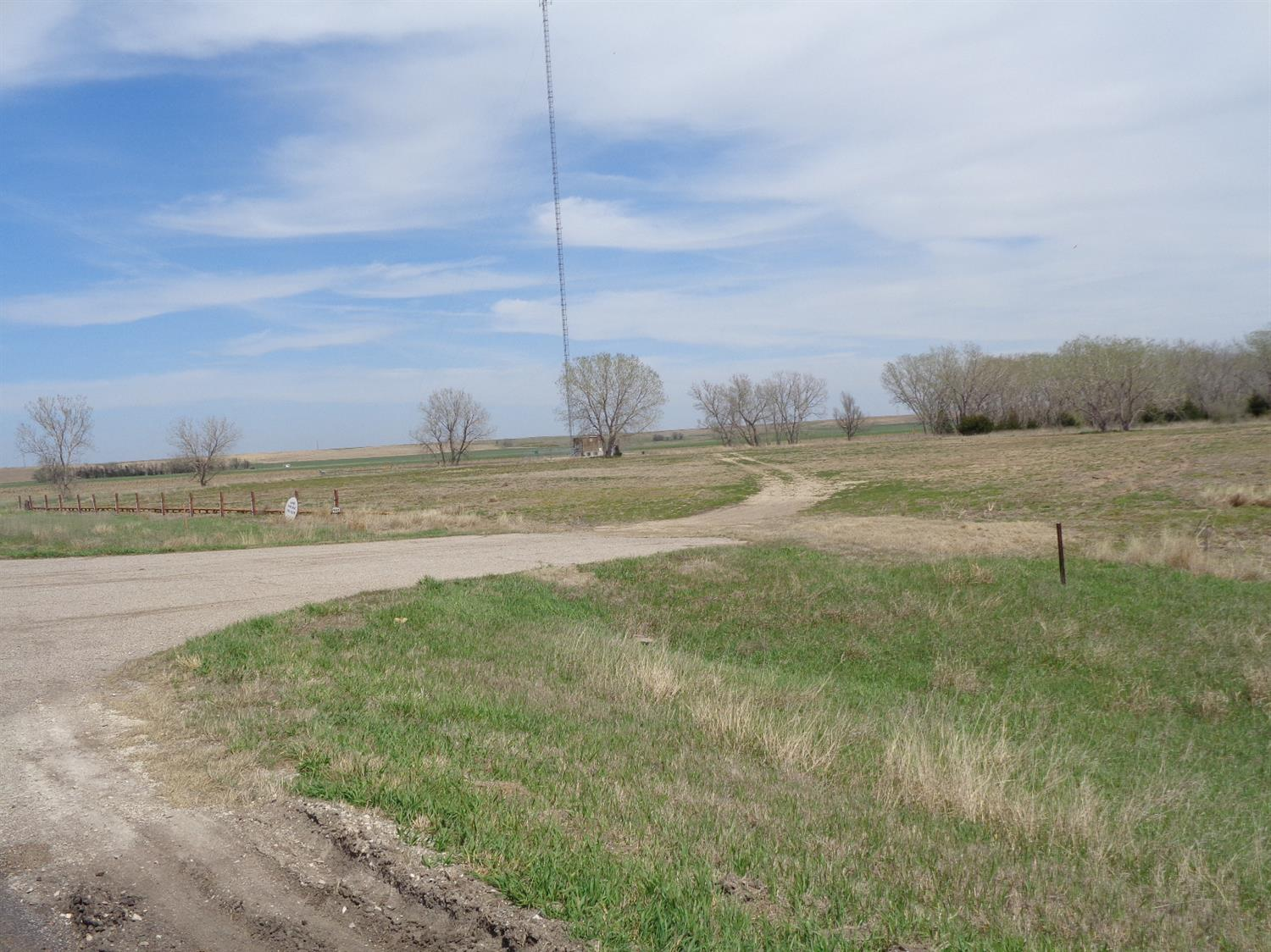 Prime commercial or industrial location on a very busy highway. It has 7 acres that are already developed for immediate use including water well and septic system. Total acreage included is +/-41.5 acres.  Enviromental reports available, 3 driveways with access to K-156 highway and approved by KDOT. Tons of rock have been hauled to this 7 acres for an excellent base to build your building. Dirt work is done on these 7 acres.  Would consider selling ag land separately.  Call Wayne for more information.