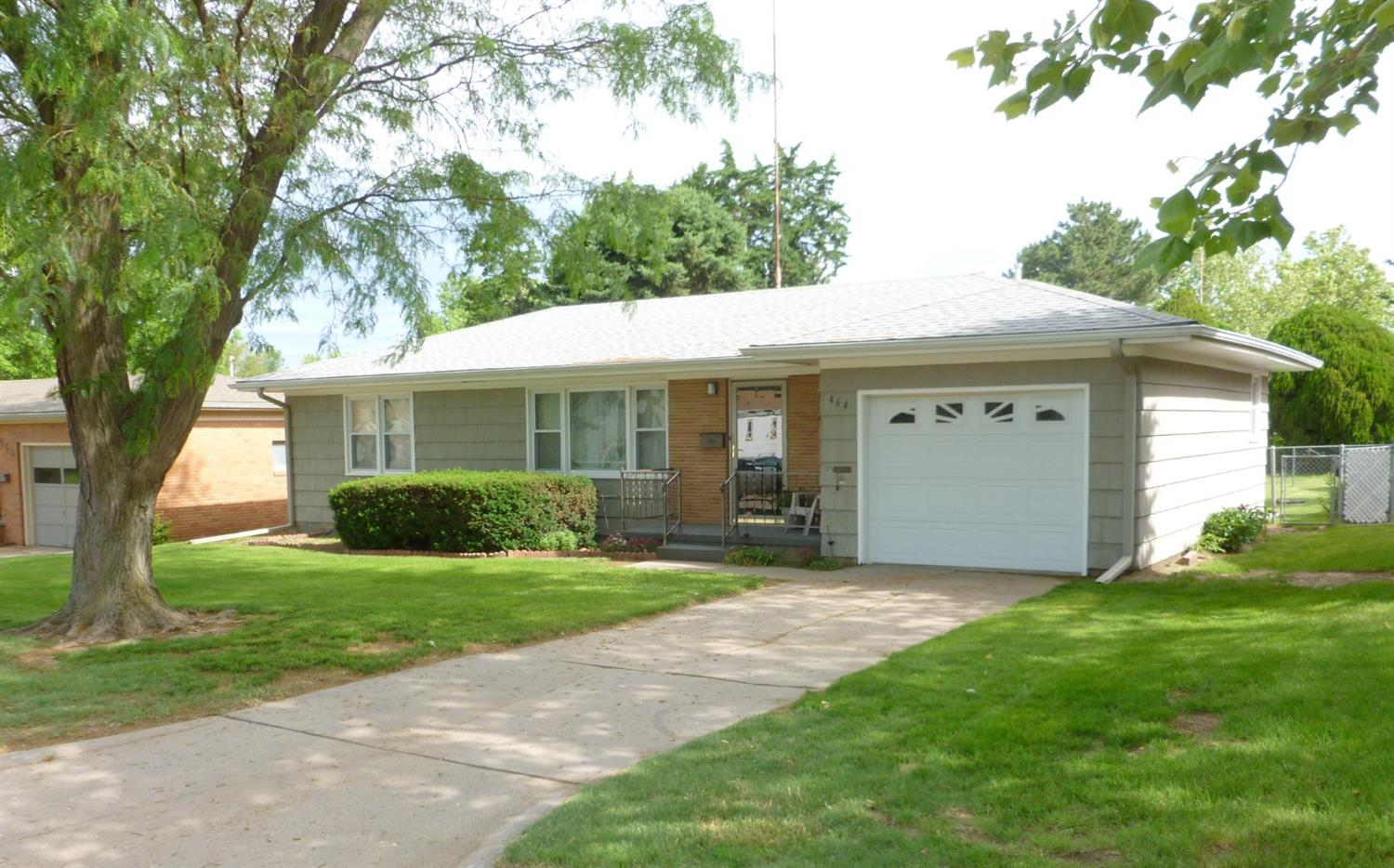 Cute 3 bedroom, 1 bath home in great Hoisington neighborhood. This home would be perfect for a first time home buyer or for someone who wants all the necessities accessible on the main floor. It has great curb appeal, boasts hardwood floors, a great backyard, plenty of shade and a 1 car garage.