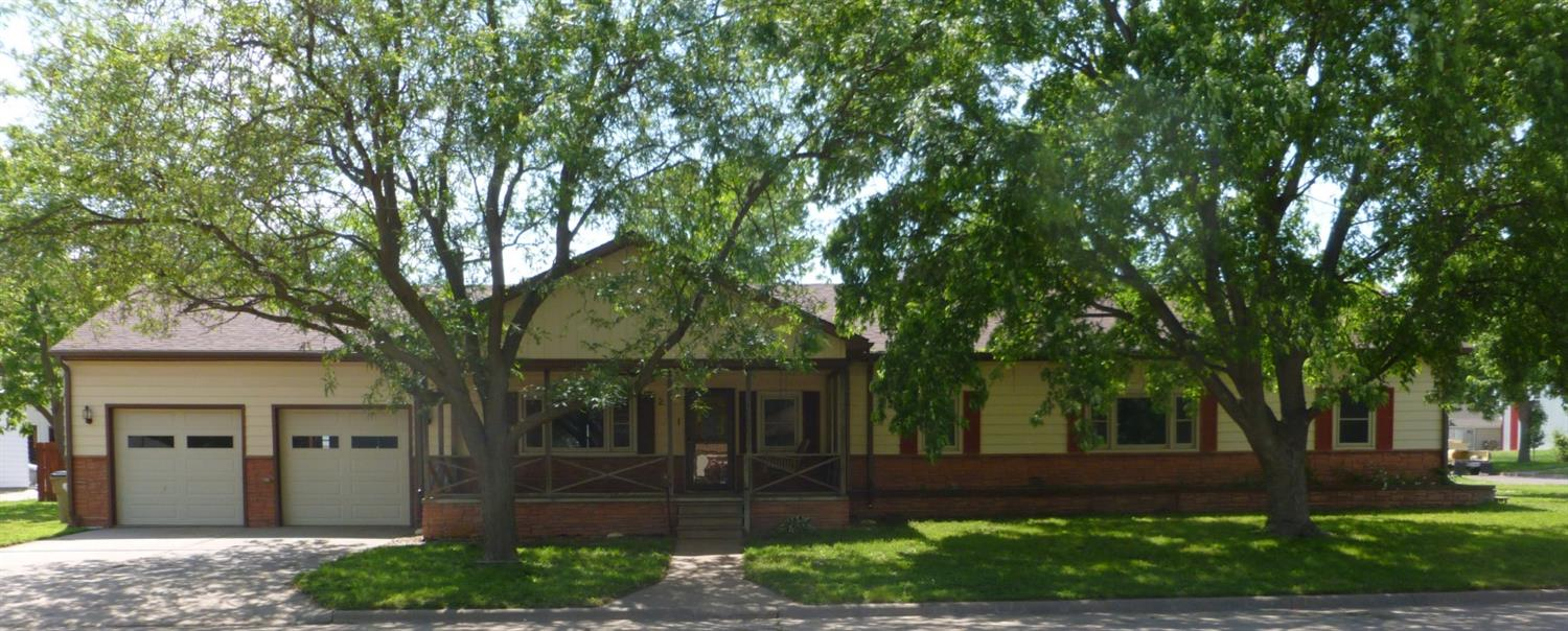 Lots of POTENTIAL in this 4 bedroom 2 bath home in Hoisington. The basics are all there, 1758 sq. ft., beautiful kitchen with breakfast bar, large living room with fireplace all on one level. This home has an oversized 2 car garage with work area and sits on a large shaded corner lot! New paint and carpet! Check out the great front porch for relaxing with friends on weekends or evenings. Value added extras include new windows with transferable warranty and recently installed 50 year composition shingles. This home is waiting for YOU!