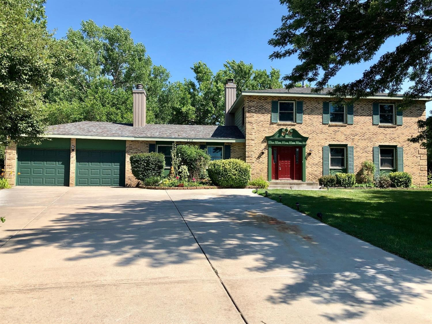 Great family home with 5 bedrooms. Master bedroom has it's own bath. Ground floor includes eat in kitchen & formal dining room, living room, 2 wood burning fireplaces, 1/2 bath, large lot & attached double garage.