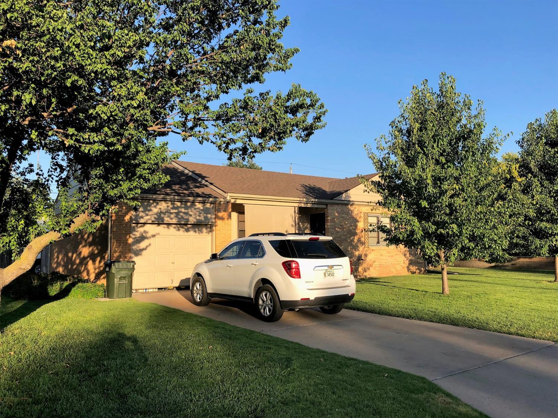 Brick 2 bedroom home with full basement, new FA & CA, new shingles, S/A garage, plus D/A carport sitting on nice corner lot.