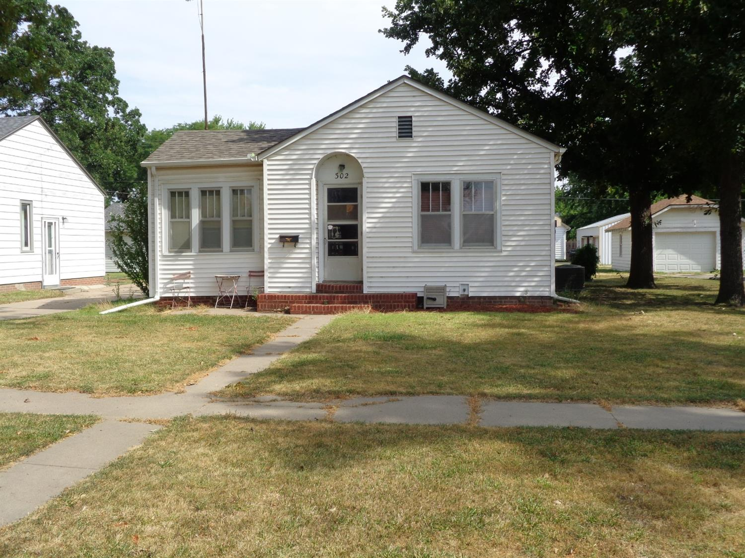 This home features an updated kitchen, 2 bedrooms, 1 bath, hardwood floors in bedrooms and single detached garage.