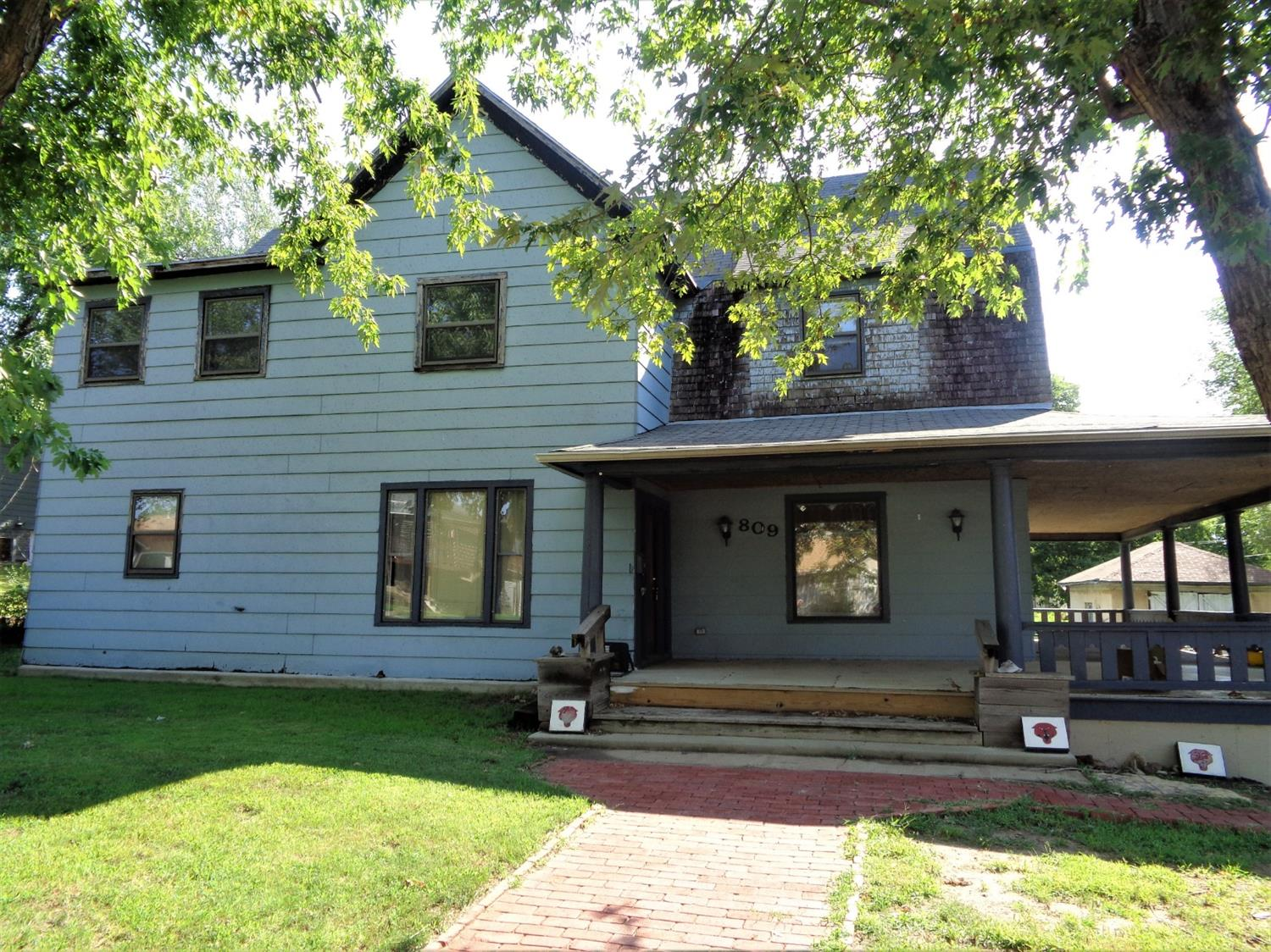 Got space? This home features 5 bedrooms, 3 baths, a great wrap around porch. With some TLC this home will shine! The AC on the south side of the house was replaced in 2011, The motor was replaced in the other unit in 2012.