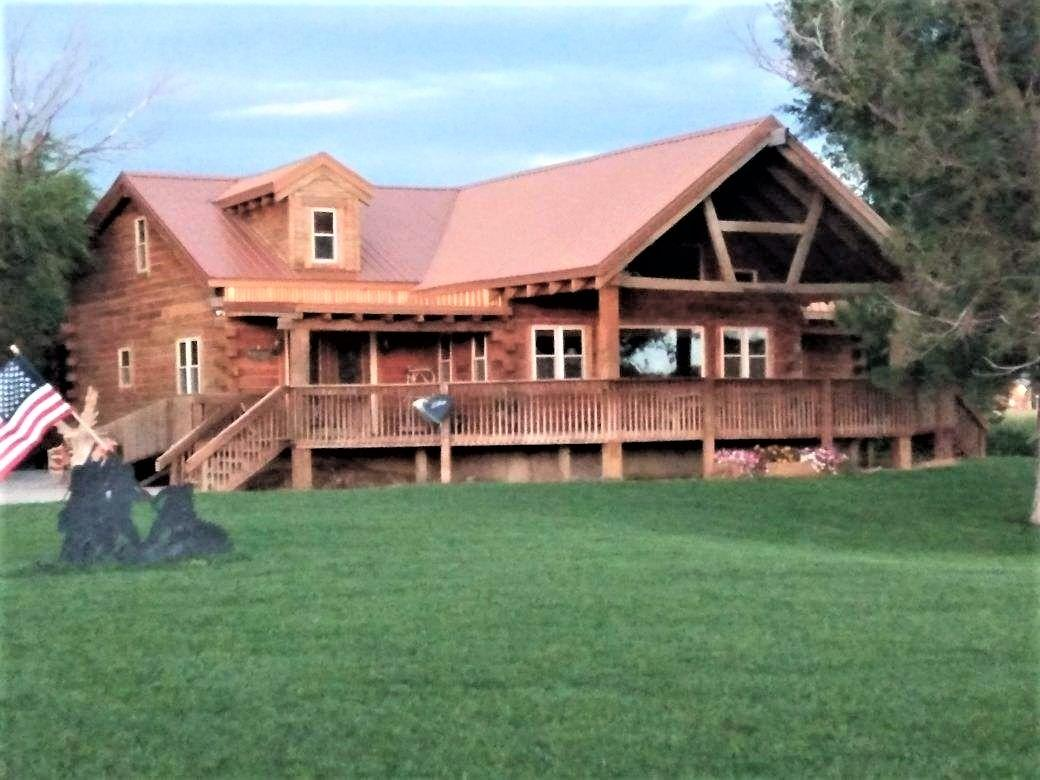 Country log home with blacktop frontage within 8 miles of Great Bend. 3 bedrooms, 1 1/2 baths. 3rd bathroom ready to install upstairs. 3 overhead doors on the 45' x 60' garage that most people wish for. Built in 2012 & sets on 2.5 +/- acres. Classy home. Classy garage. Classy setting. Call us today to view this one of a kind home.