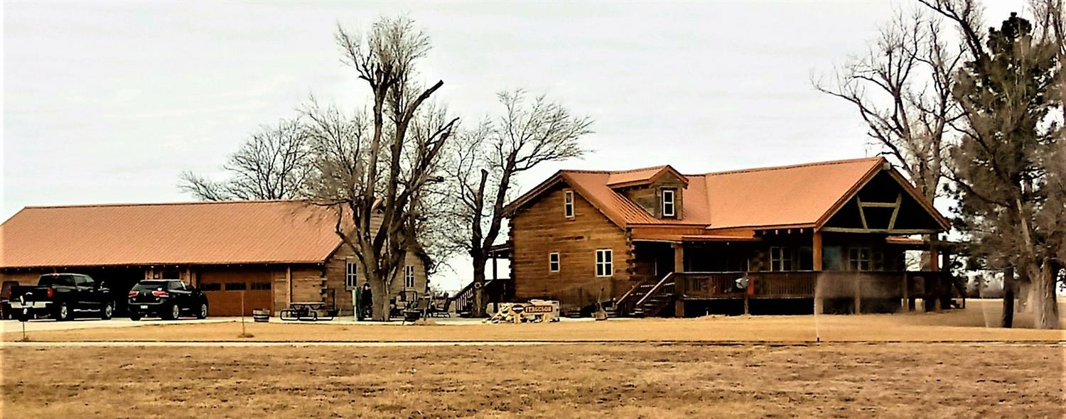 If you like a TRUE log cabin...Don't miss out on this home. The extras are AWESOME! Within 8 miles of Great Bend on blacktop frontage, wrap around porch, 45' x 60' garage with over-sized cement drive. 3 bedrooms, 1 1/2 baths. 3rd bathroom ready to install upstairs. Built in 2012 & sets on 2.5 +/- acres. This home is total electric! No gas or water bills. Call us today to view this one of a kind home.