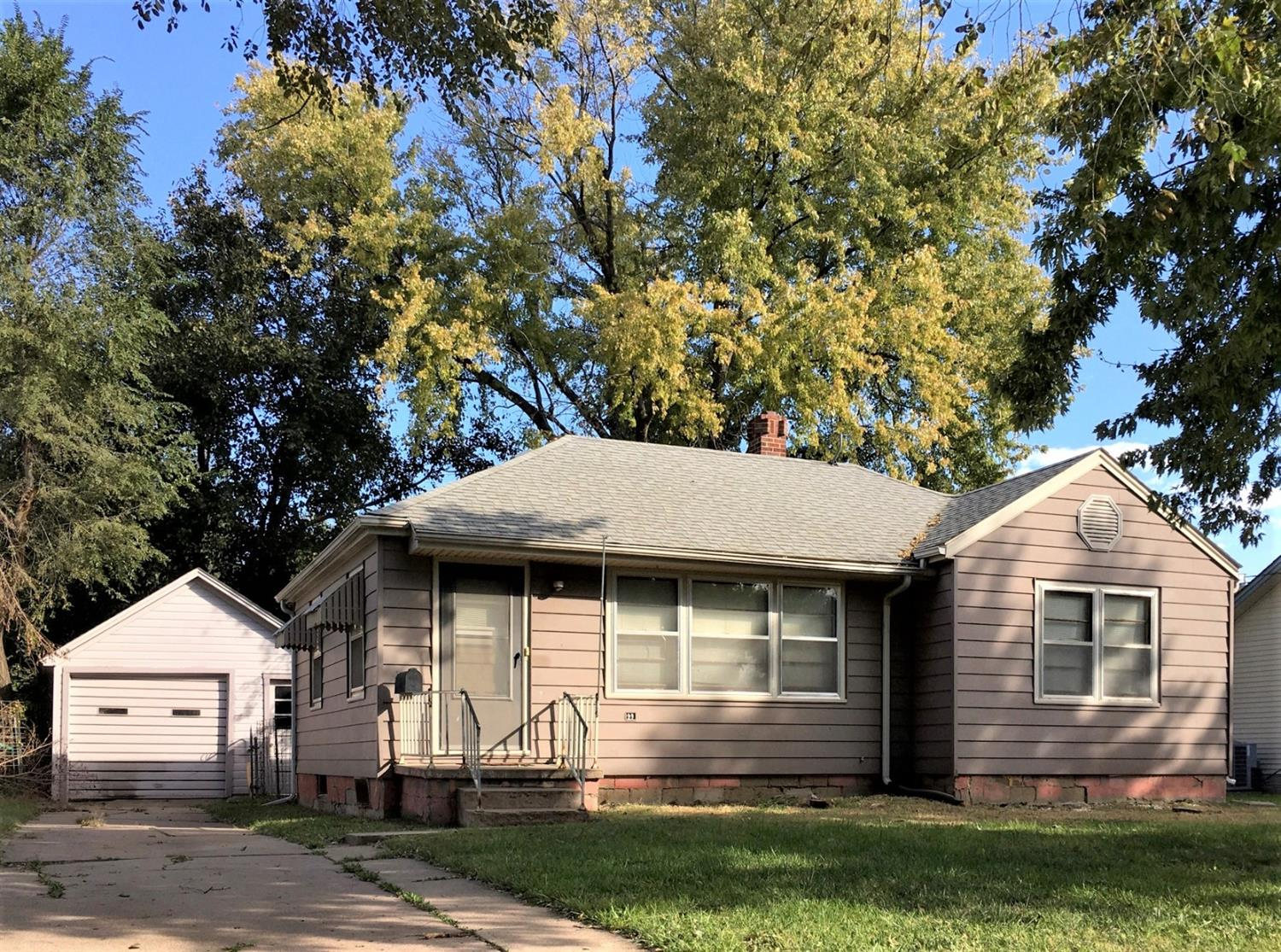 WHY RENT?!...When you can own for less! 2 bd/1 bath with full unfinished basement. Hardwood floors underneath carpet. 1-car detached garage. PLUS huge fenced in backyard!! What a bargain!