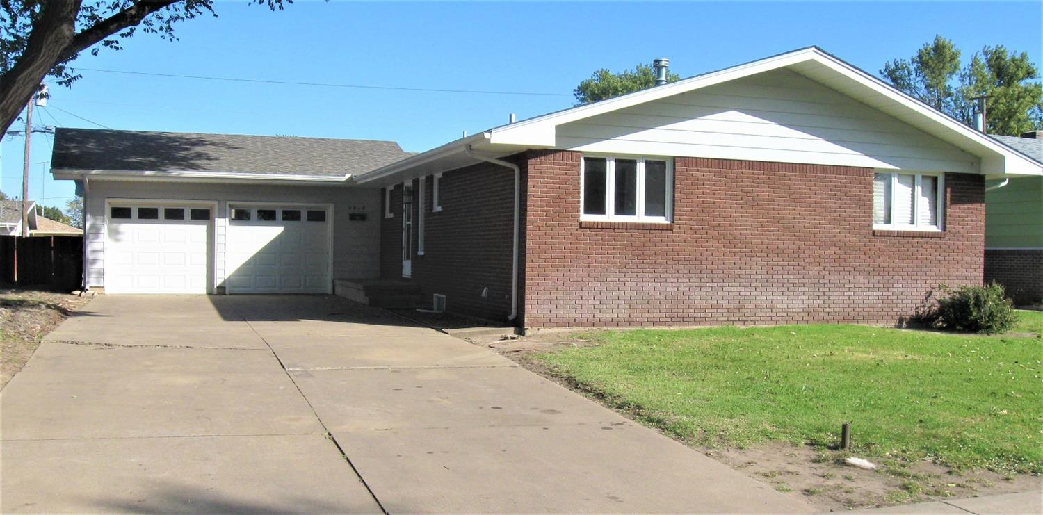 Neat & clean brick & steel sided ranch style home featuring living room with w/b fireplace, kitchen with eating area, 3 bedrooms, finished basement with family room including w/b fireplace and wet bar, 2nd bathroom, 4th bedroom, FA & CA, wood privacy fence and D/A garage.