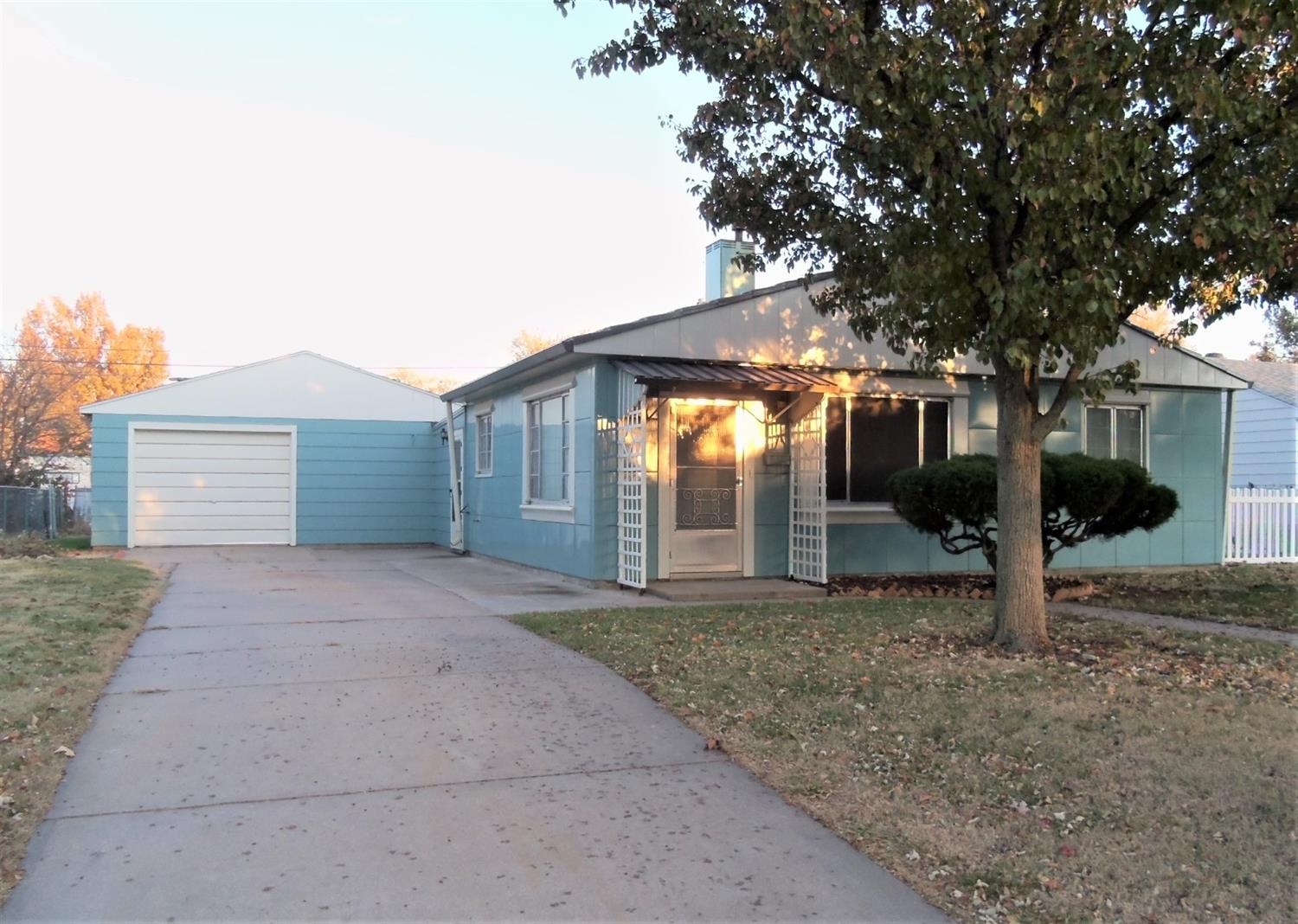 Why rent when you can own this very neat and clean two bedroom home that's move in ready?  Living room, kitchen with range and dining area, separate utility room, updated bath, spacious family room and attached garage and fenced yard.  Lustron home, garage has newer comp. shingles.