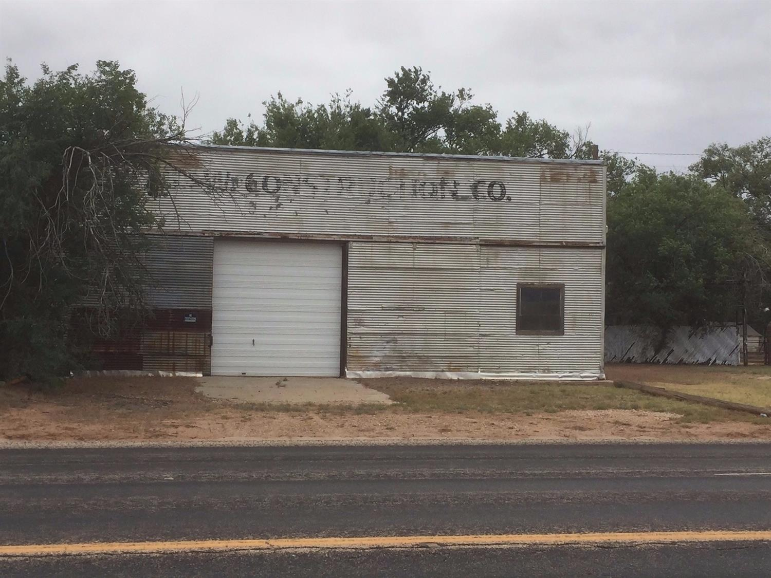 Metal Warehouse Building in Sundown.  Almost 1/2 acre corner lot with 3100 sq. ft. building with extra tall walls, 1 overhead and 2 large sliding door accesses.  Plus 20' x 40' metal carport and small fenced storage yard.  Very Affordable!  Call Today!