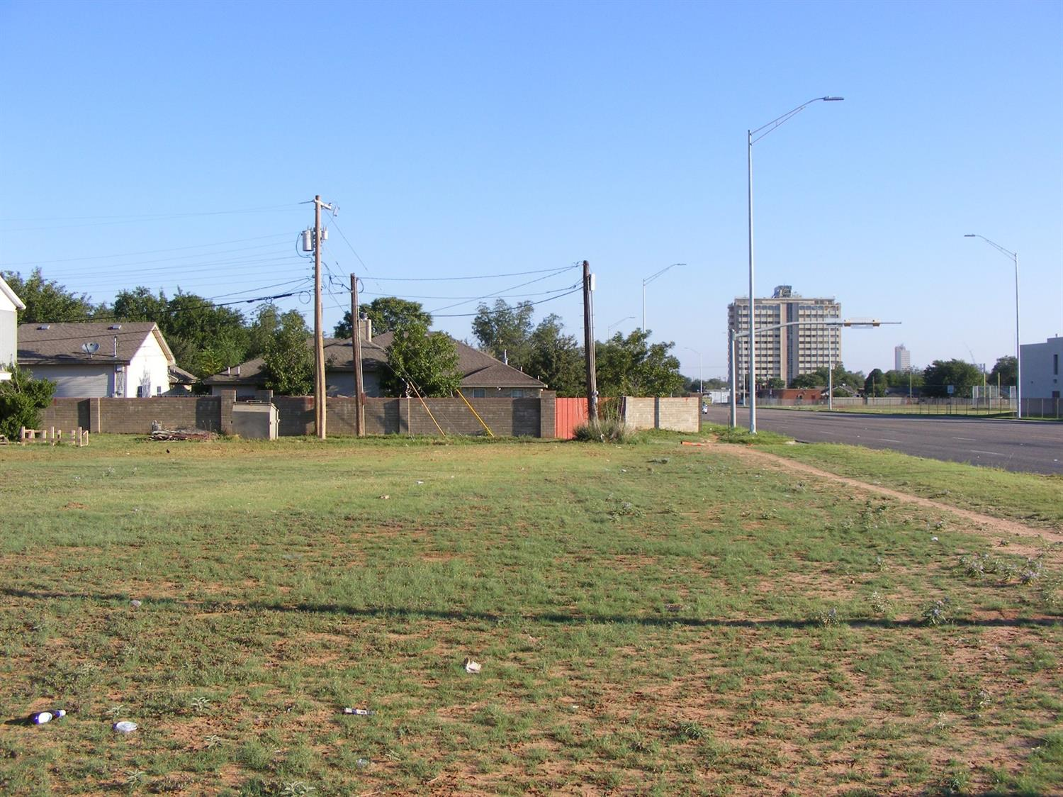 Three prime commercial lots with Avenue Q frontage and two residential lots, one with a house, are available for sale. All lots are contiguous and possibly rezoned commercial/residential.