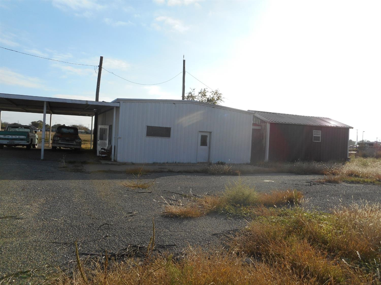 1.5 acres fenced w/ water well.  Has 1200 sq. ft shop, 1600 sq. ft carport & 308 sq. ft office w/ bathroom.