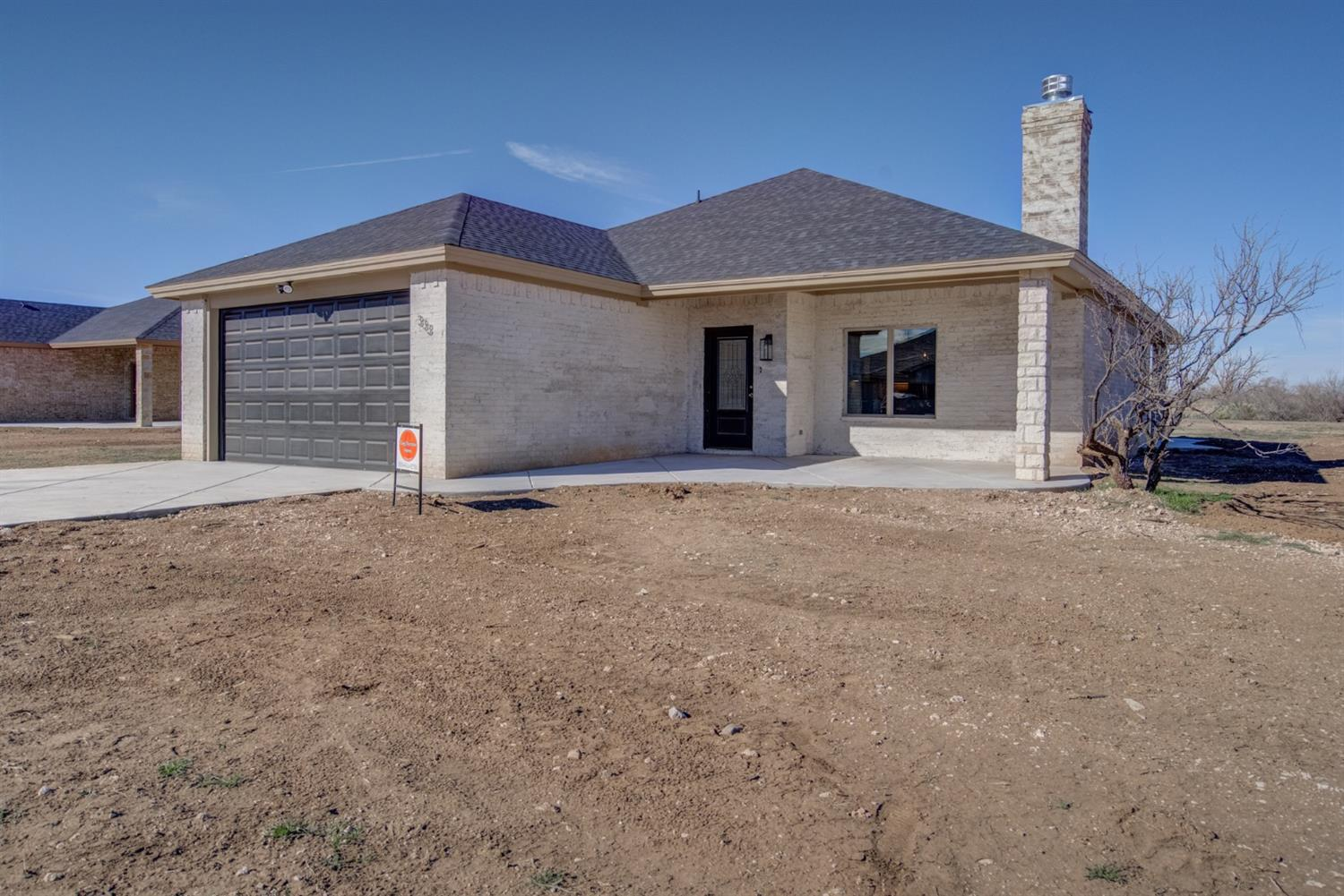 Beautiful brand new home at Buffalo Springs Lake.  This home features 3 bedrooms, 2 bathrooms and a 2 car garage with epoxy flooring.  Luxury vinyl plank flooring throughout, lovely corner brick fireplace, granite in the kitchen and both bathrooms and a desireable open concept kitchen, dining area and living room.   The kitchen has a large breakfast bar/island and a full appliance package including refrigerator. This home has wonderful covered front porch and a covered patio in the back.  This home is perfect for entertaining and sits on a .3294 lot.  Come enjoy all of the amazing amenities the lake has to offer while enjoying your new home!