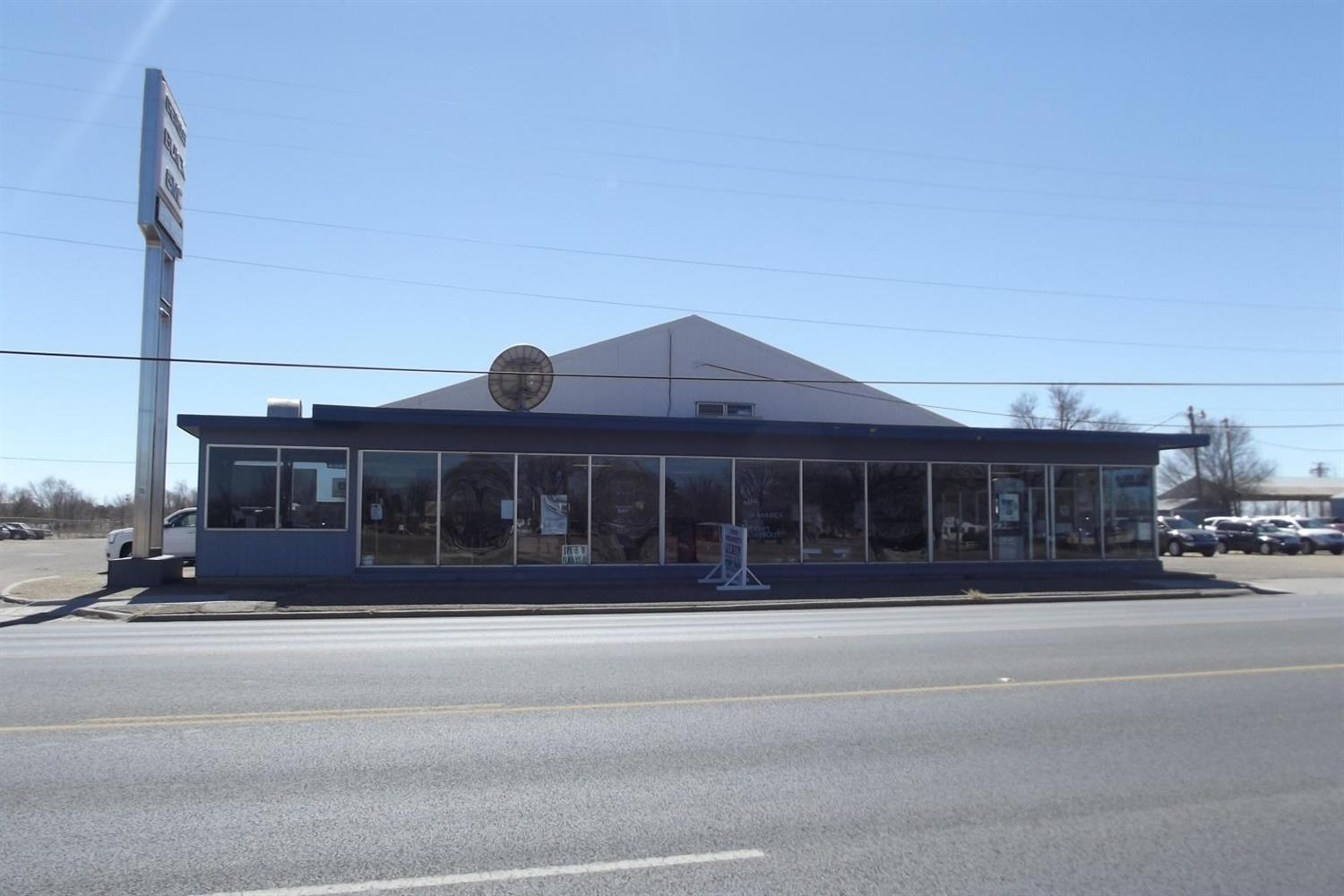 Excellent corner commercial property on well traveled busy street~ the corner of 5th (HWY 70) and Joliet Street. The main building has a showroom, offices, parts room, and a large shop wit multiple 20' overhead doors. 13,656 SF~ Showroom/Parts/Shop, 10,780 SF~Shops 2@3, 2,600 SF Paint/Storage, 3,780 SF Body Shop. It has 6.44 acres.