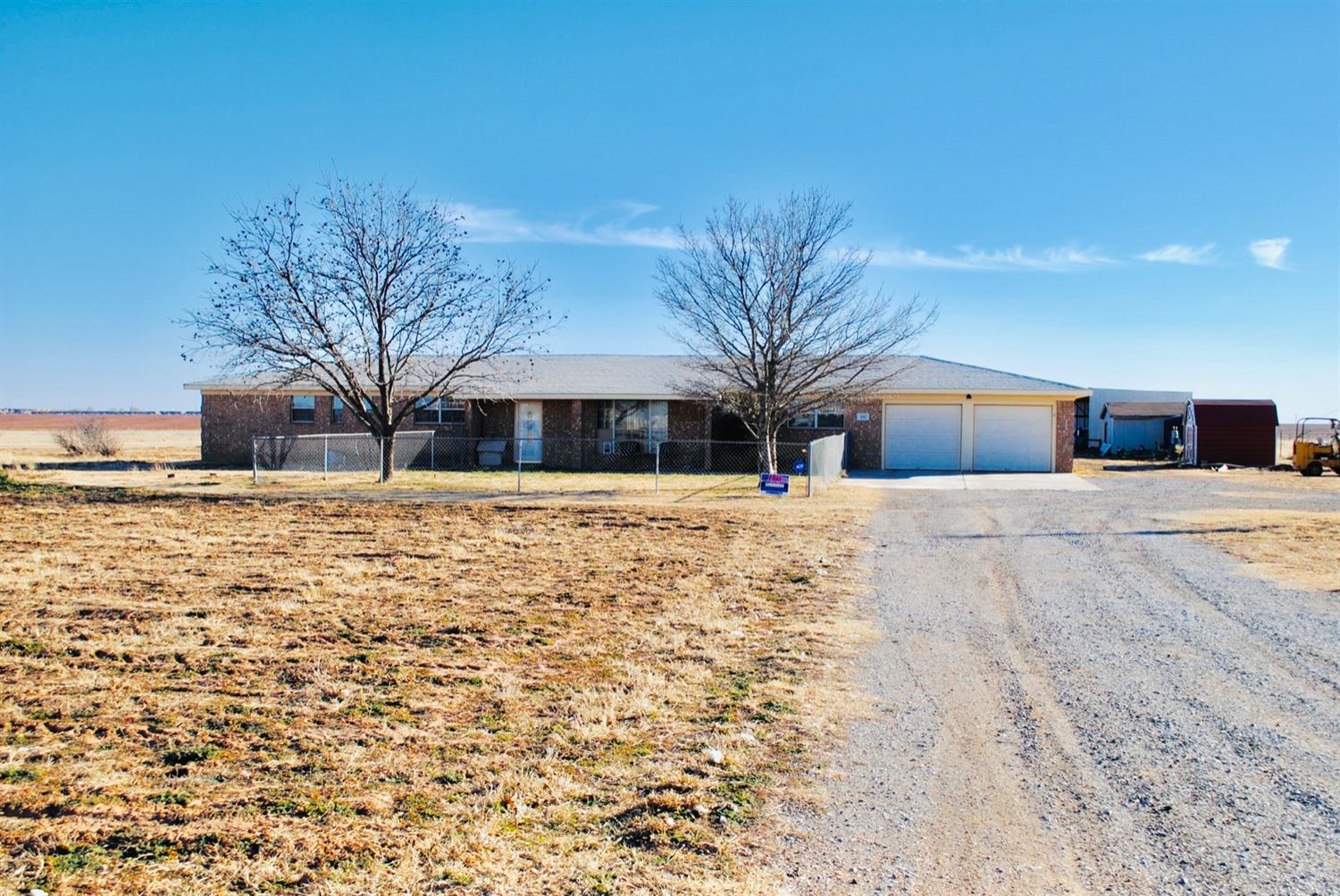 5 acres in South Lubbock! Great home on 1 acre with 4 additional acres alongside! 4 acres have RV/mobile home lots with utility hook ups and a well; great potential for monthly income. See private remarks for details on monthly rent. Motivated seller, bring your buyers today!